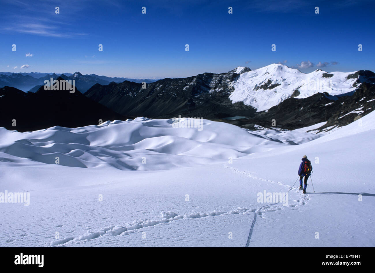 Mountain climber travels on a glacier Cordillera Real, Bolivia - Stock Image