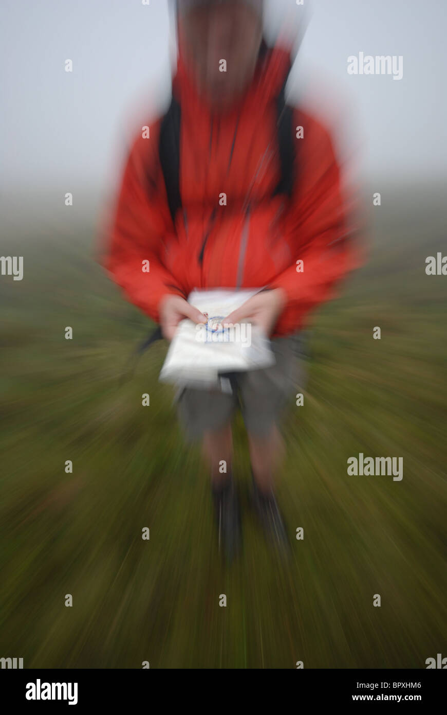 Micro navigtation in the mist on the featureless Ulpha fells, of the Lake District, UK - Stock Image