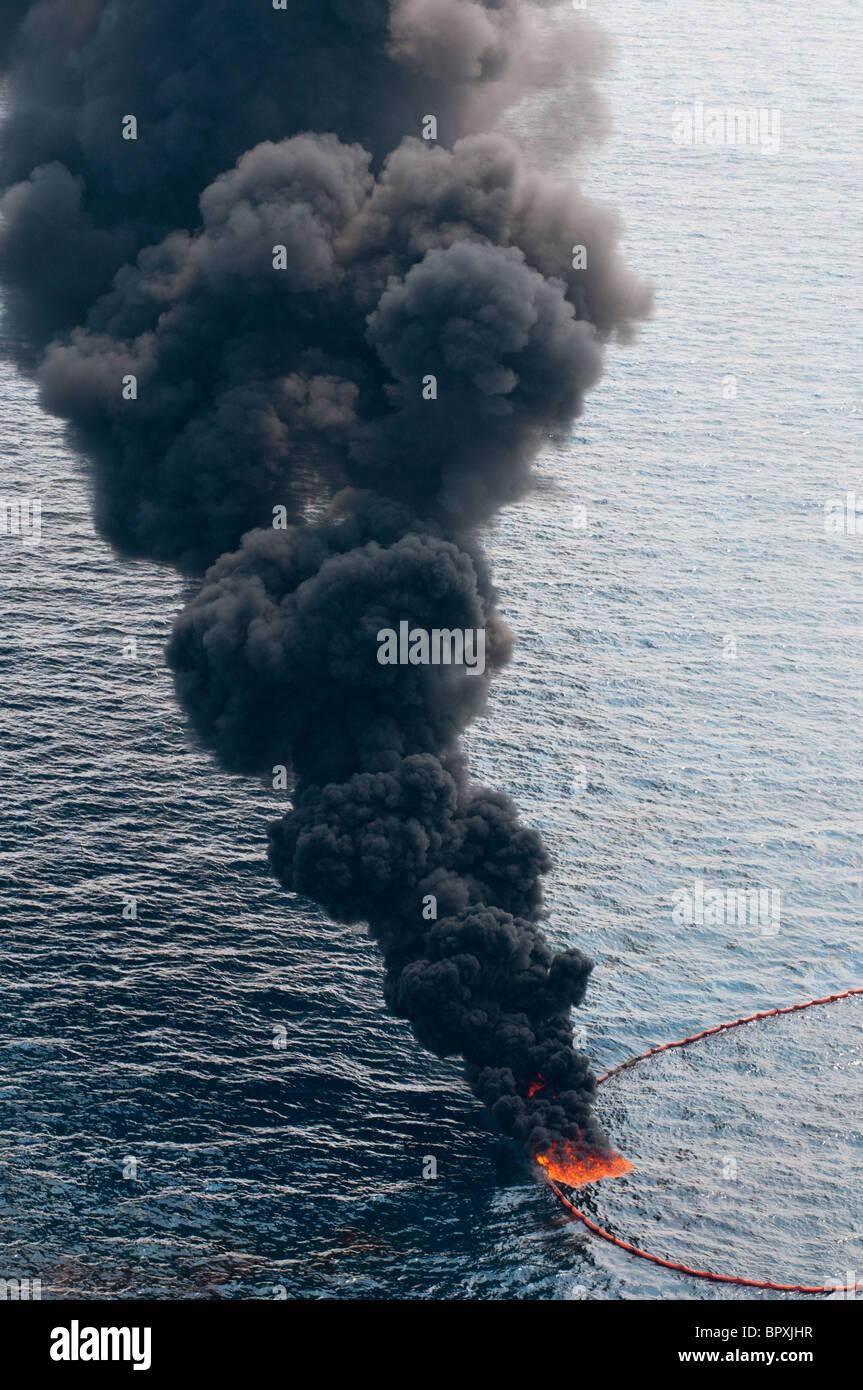 Insitu burn, seven miles north of the source MC 252 site, Gulf of Mexico, Louisiana, USA. - Stock Image