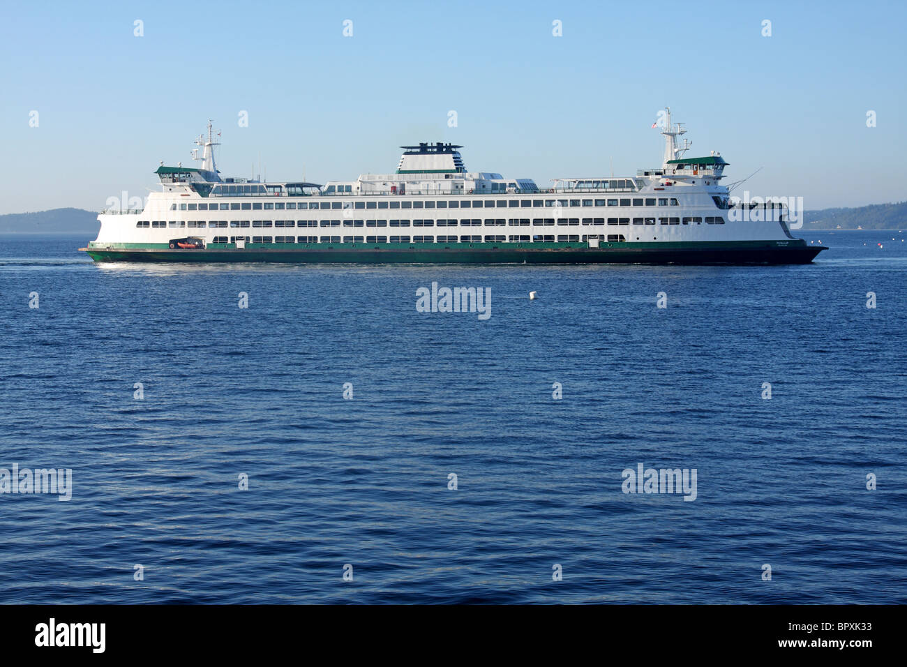 The Washington State Ferry Puyallup approaches the terminal at Edmonds, Washington. Stock Photo