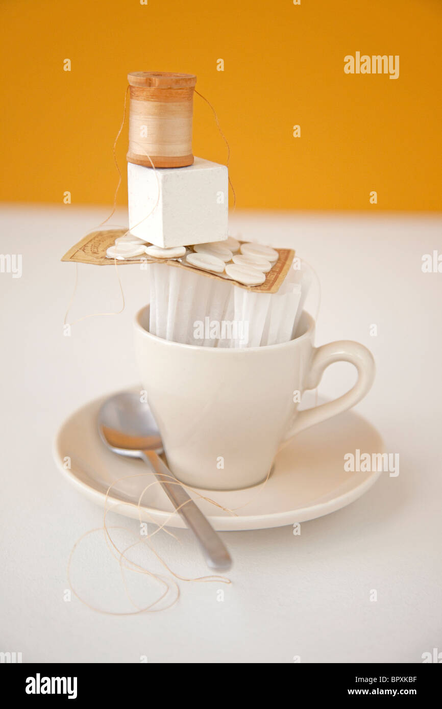 balanced coffee cup with other items - Stock Image