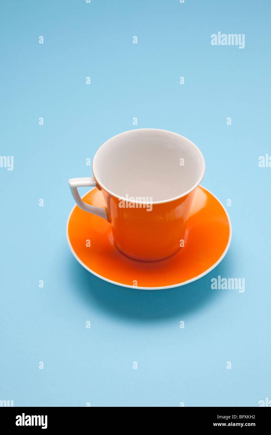 orange coffee cup - Stock Image