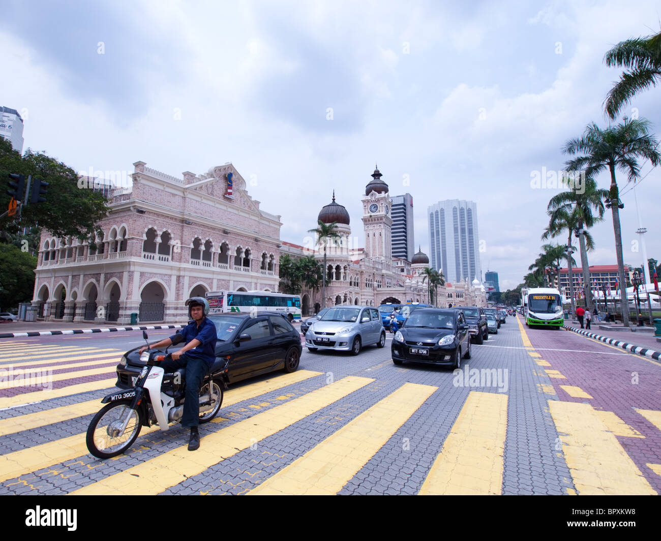 A busy street scene from Kuala Lumpur, Malaysia, with the Sultan Abdul Samad Building in the background. - Stock Image