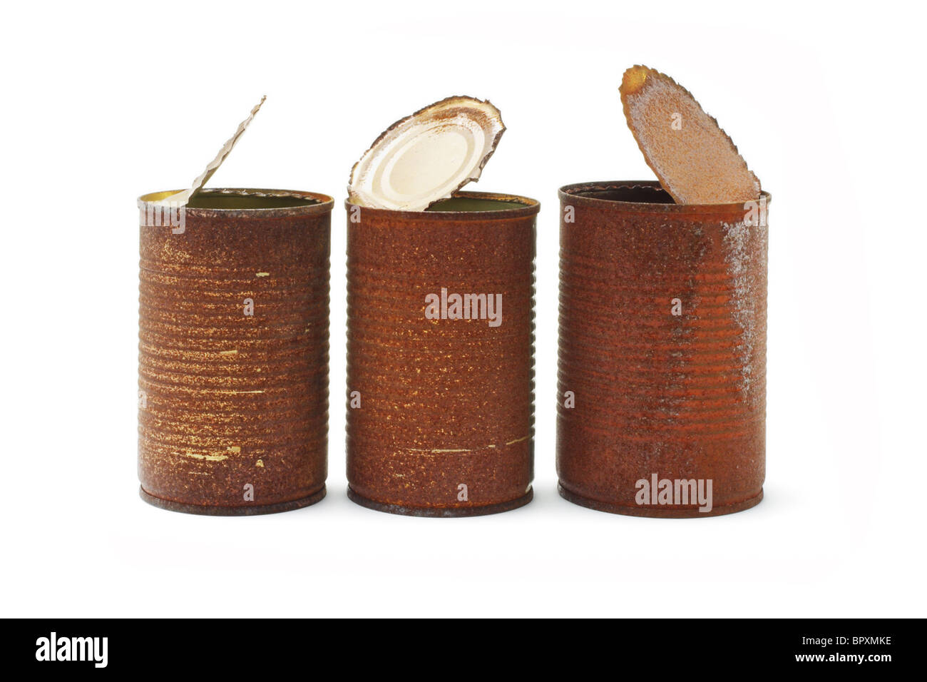 Rusty tin cans arranged on white background - Stock Image