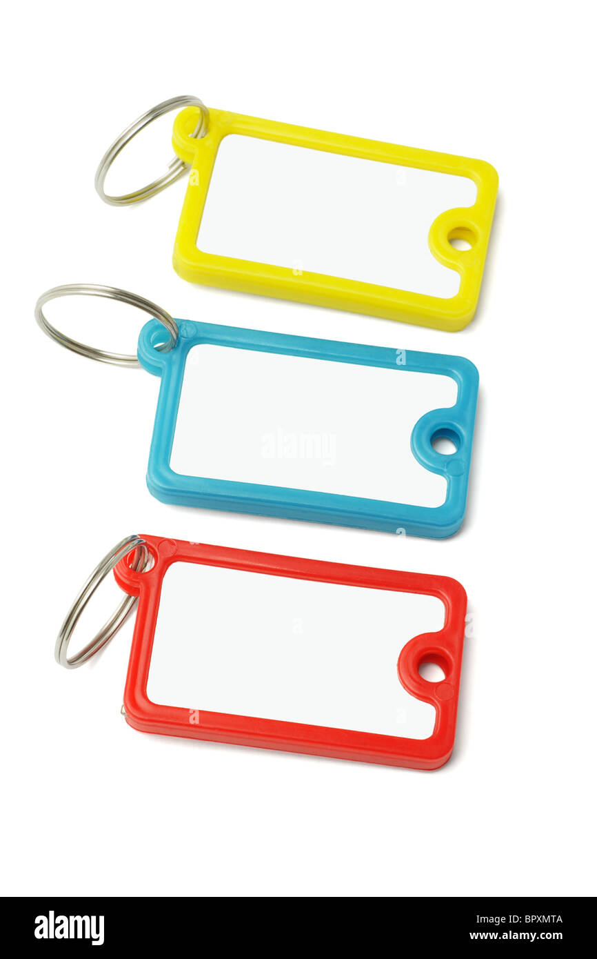 Multicolor plastic key labels on white background - Stock Image