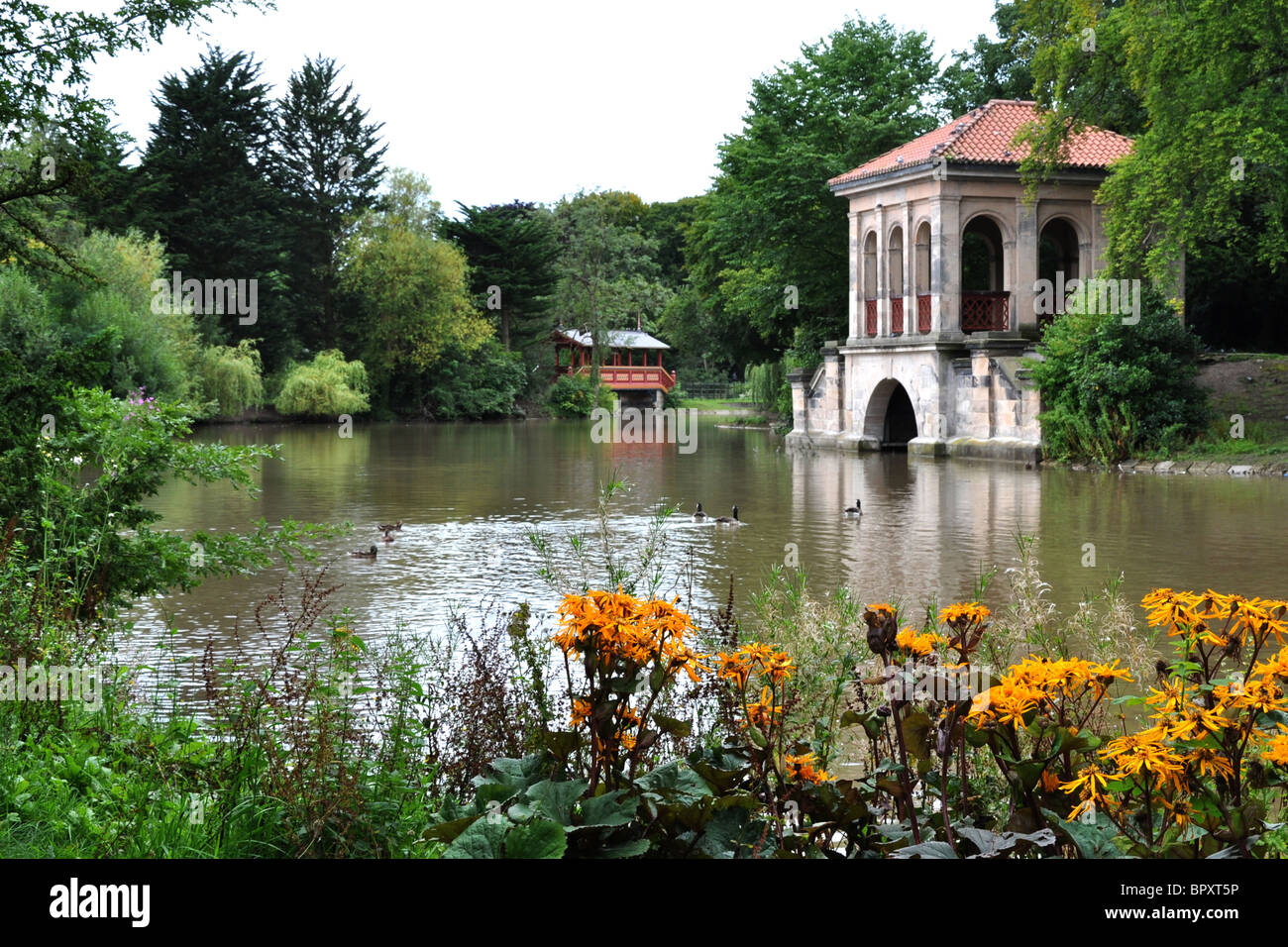 The Swiss bridge and the boathouse in Birkenhead Park - Stock Image