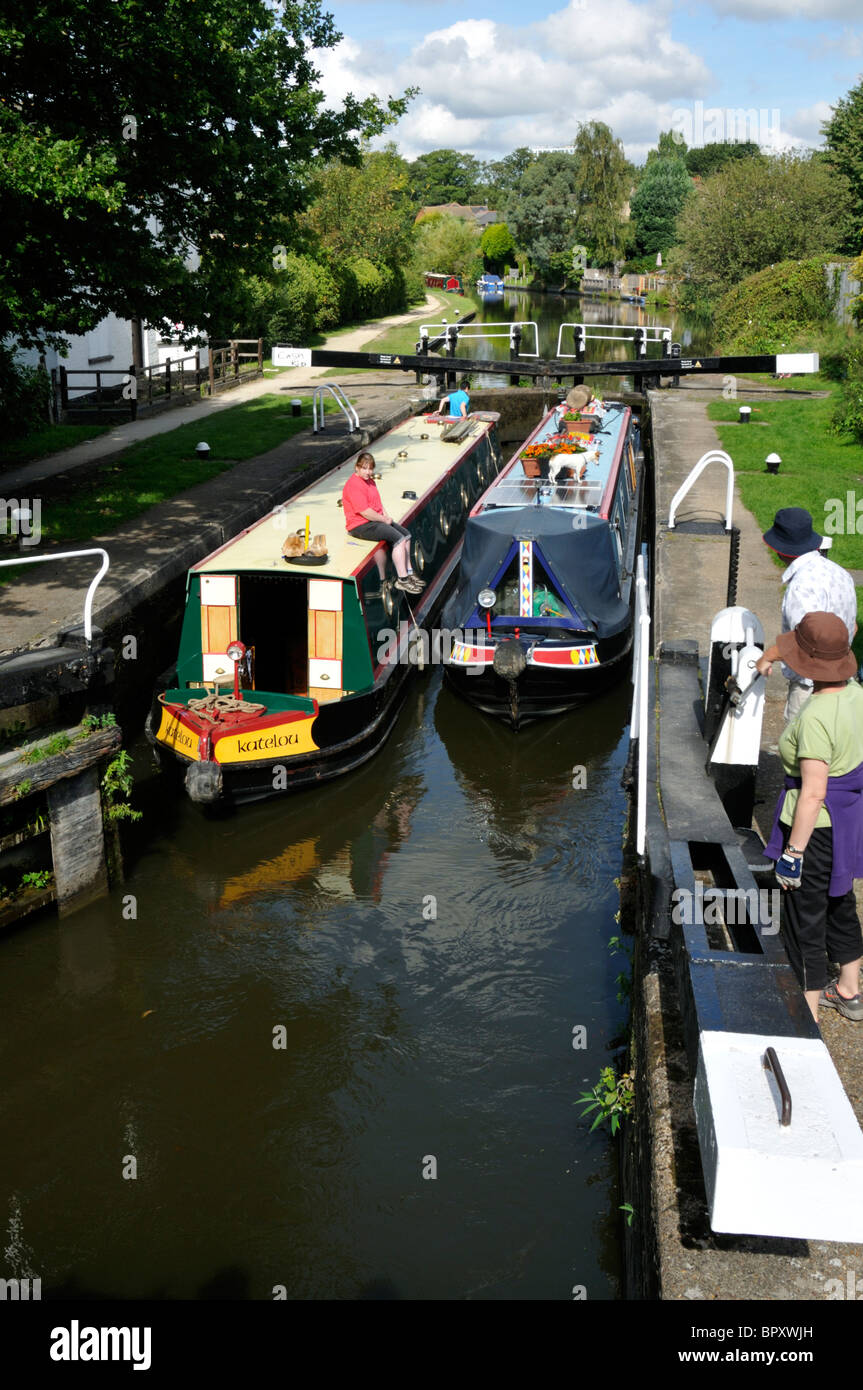 Two narrow boats in Apsley Lock 65 on the Grand Union Canal, Hertfordshire, UK. - Stock Image