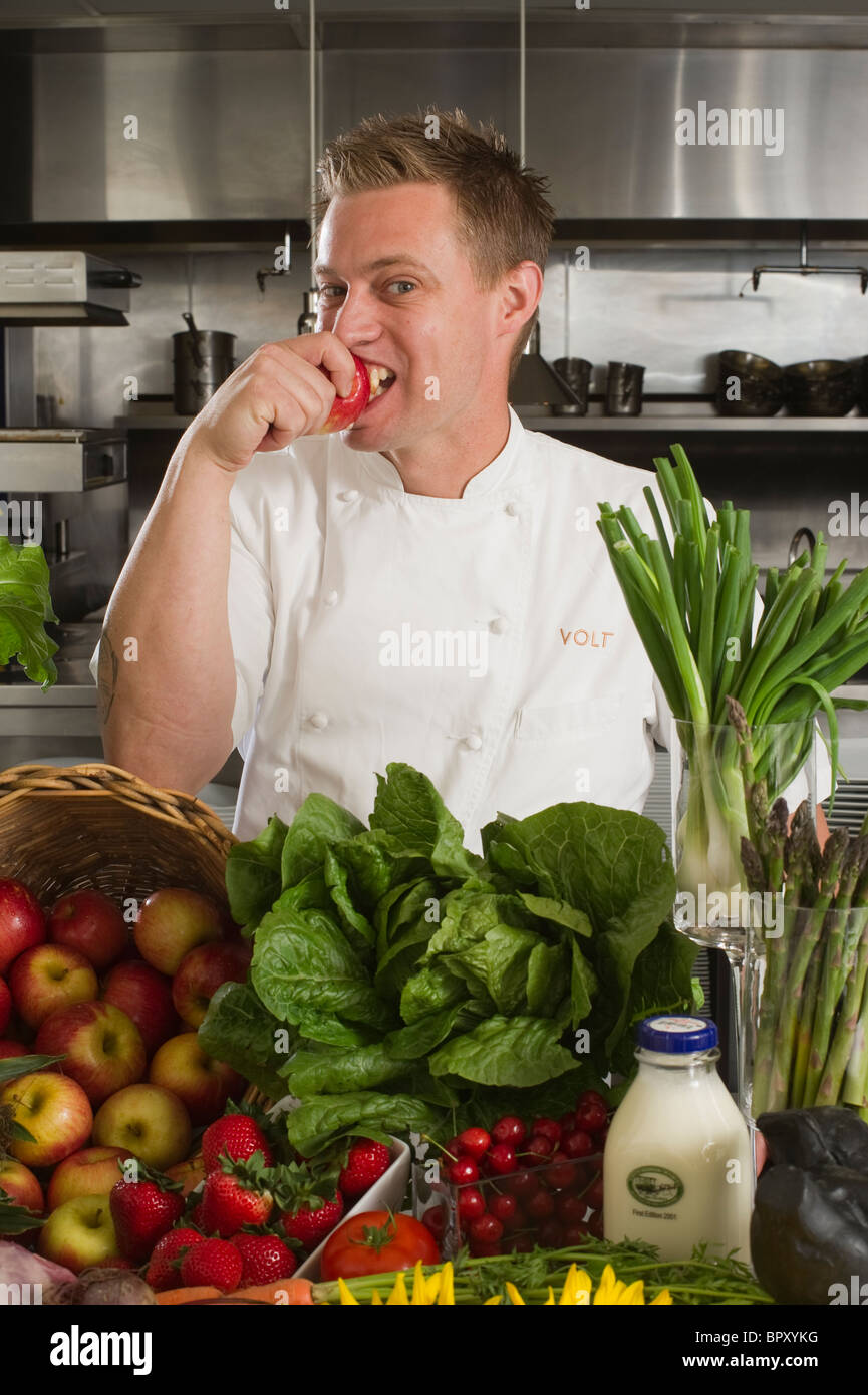 Chef Brian Voltaggio , Frederick MD, with Fruits and vegetables in a kitchen - Stock Image
