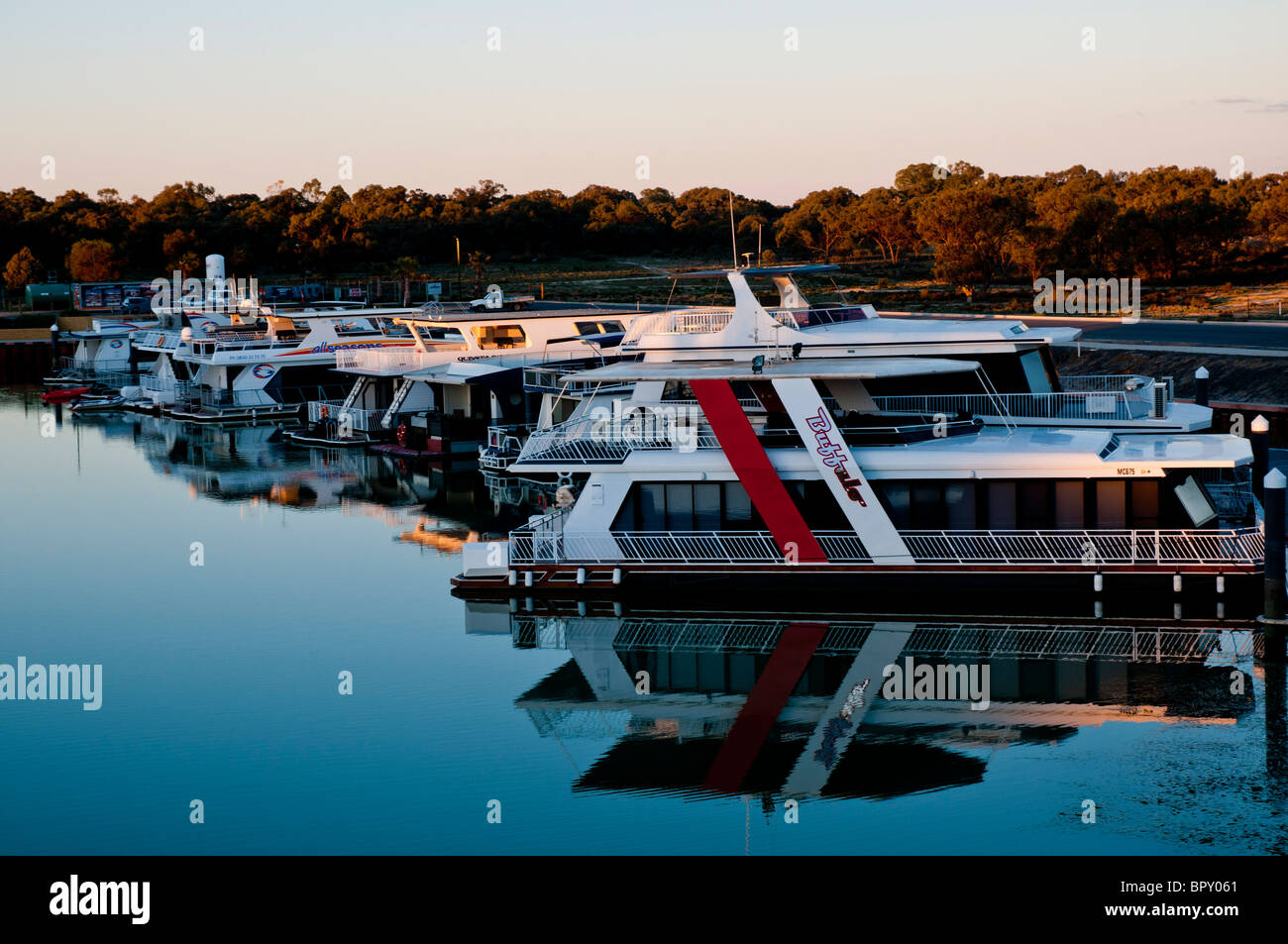 Luxury house boats moored in a basin of the Murray River in Mildura, Victoria, Australia Stock Photo