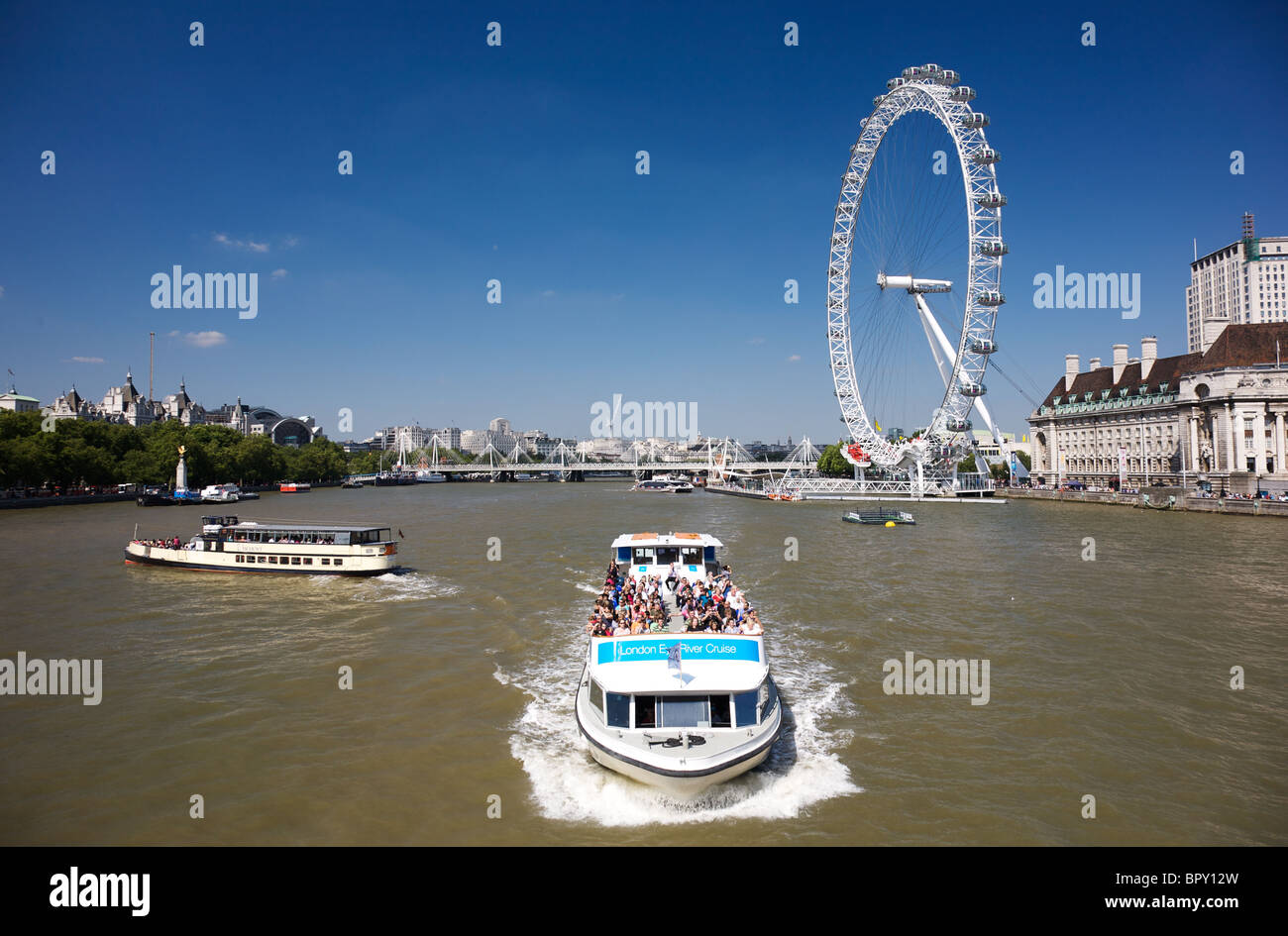 River Cruise boat on the River Thames with the London Eye in the background, London - Stock Image
