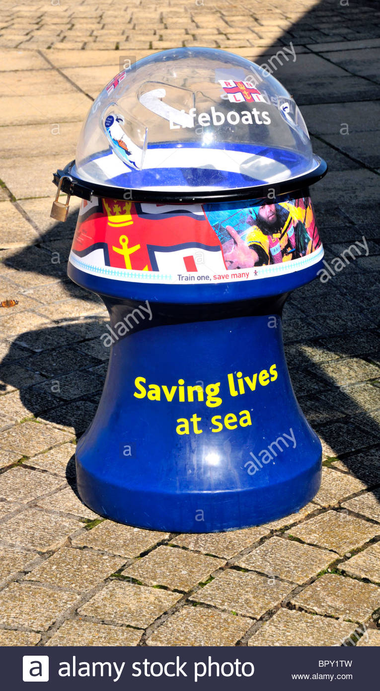 a rnli blue donation collection money box for the royal national lifeboat institute institution - Stock Image