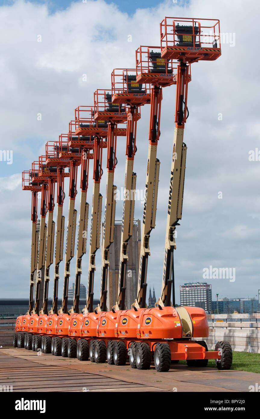 Tower waggons standing in a perfect row. - Stock Image