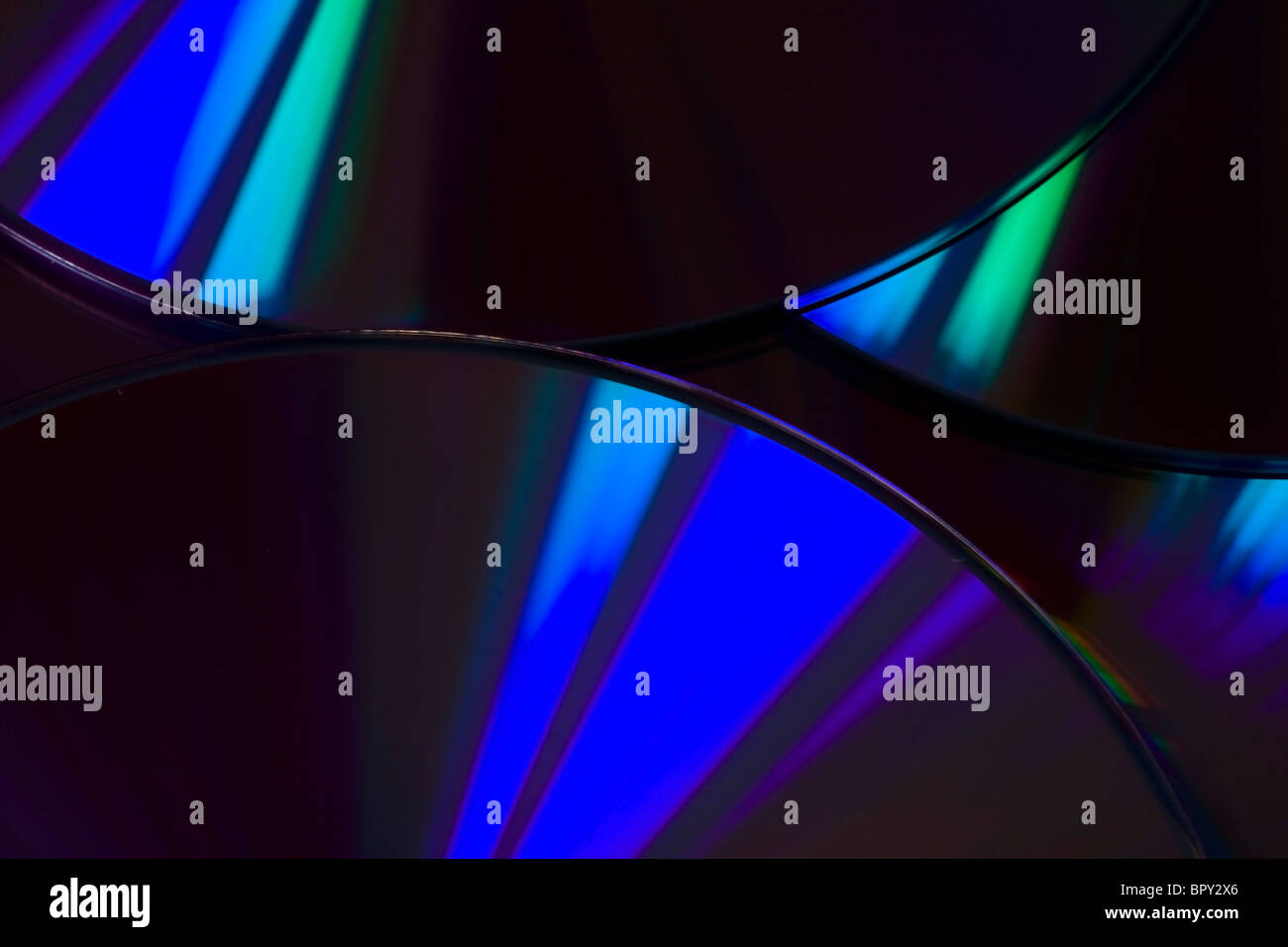 Many colorful DVD lying upon each other - landscape format - Stock Image