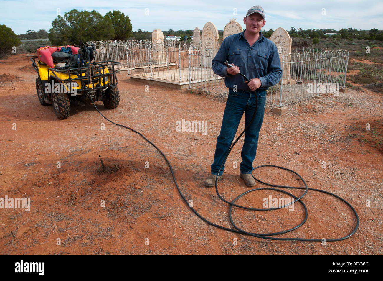 Herbicide sprayer in the historical cemetery at Silverton outside Broken Hill in outback New South Wales - Stock Image