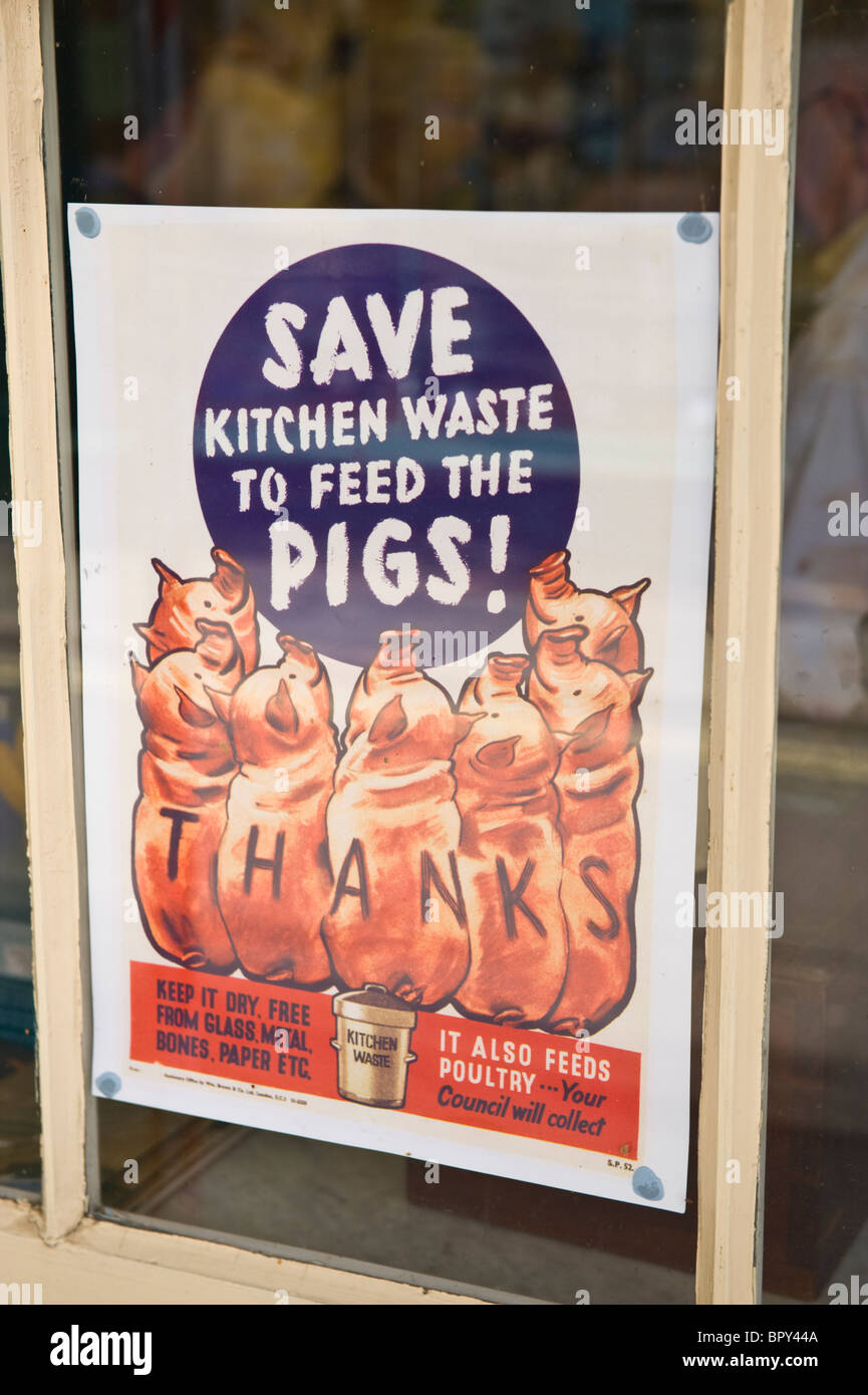 SAVE KITCHEN WASTE WW2 poster in shop window for 1940s event UK - Stock Image