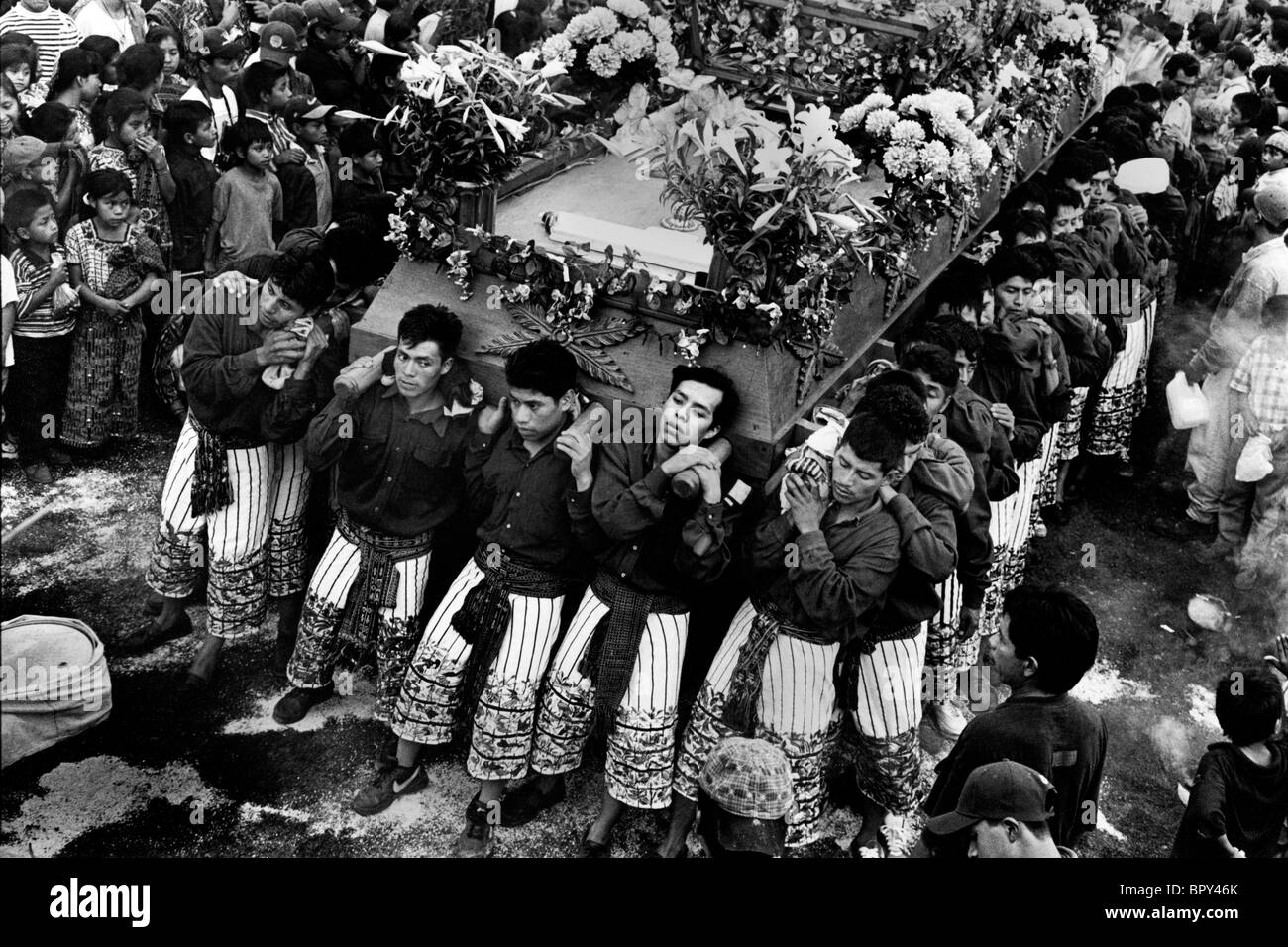 Men carry the symbolic coffin of Christ through the streets during Holy Week celebrations. Guatemala - Stock Image