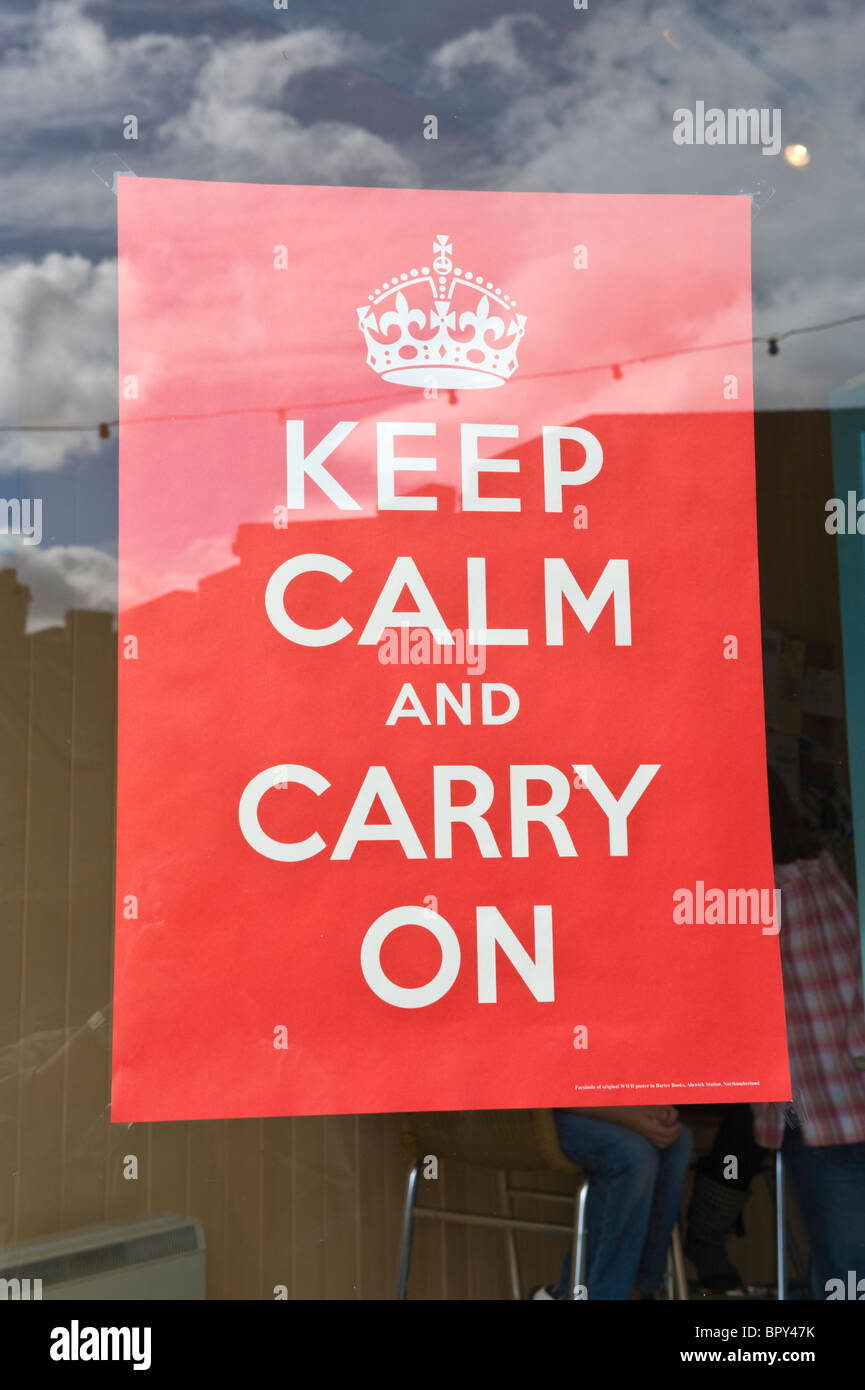 KEEP CALM AND CARRY ON WW2 poster in shop window for 1940s event UK - Stock Image