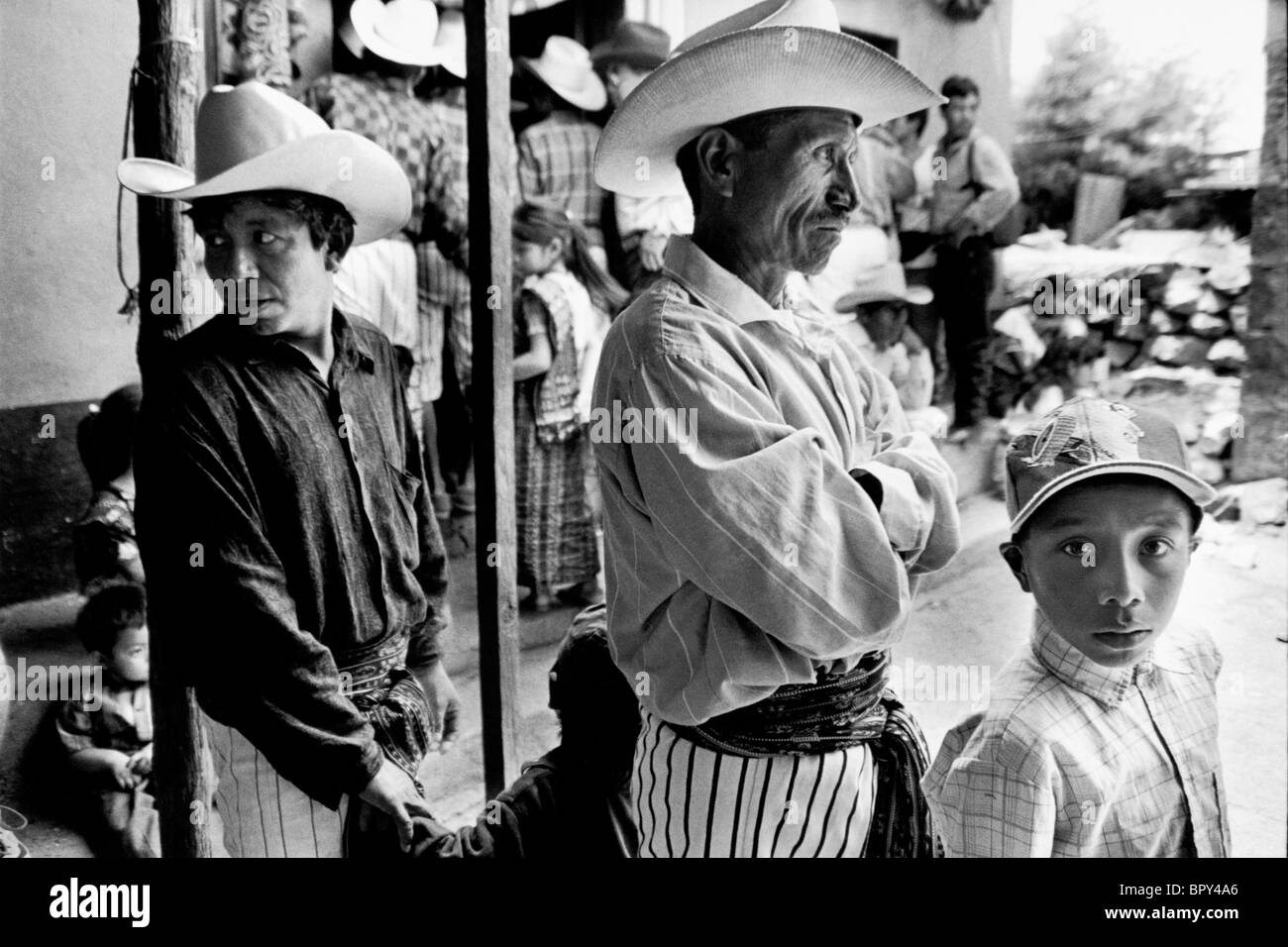 Villagers at the door to Saint Maximon's house. Guatemala - Stock Image