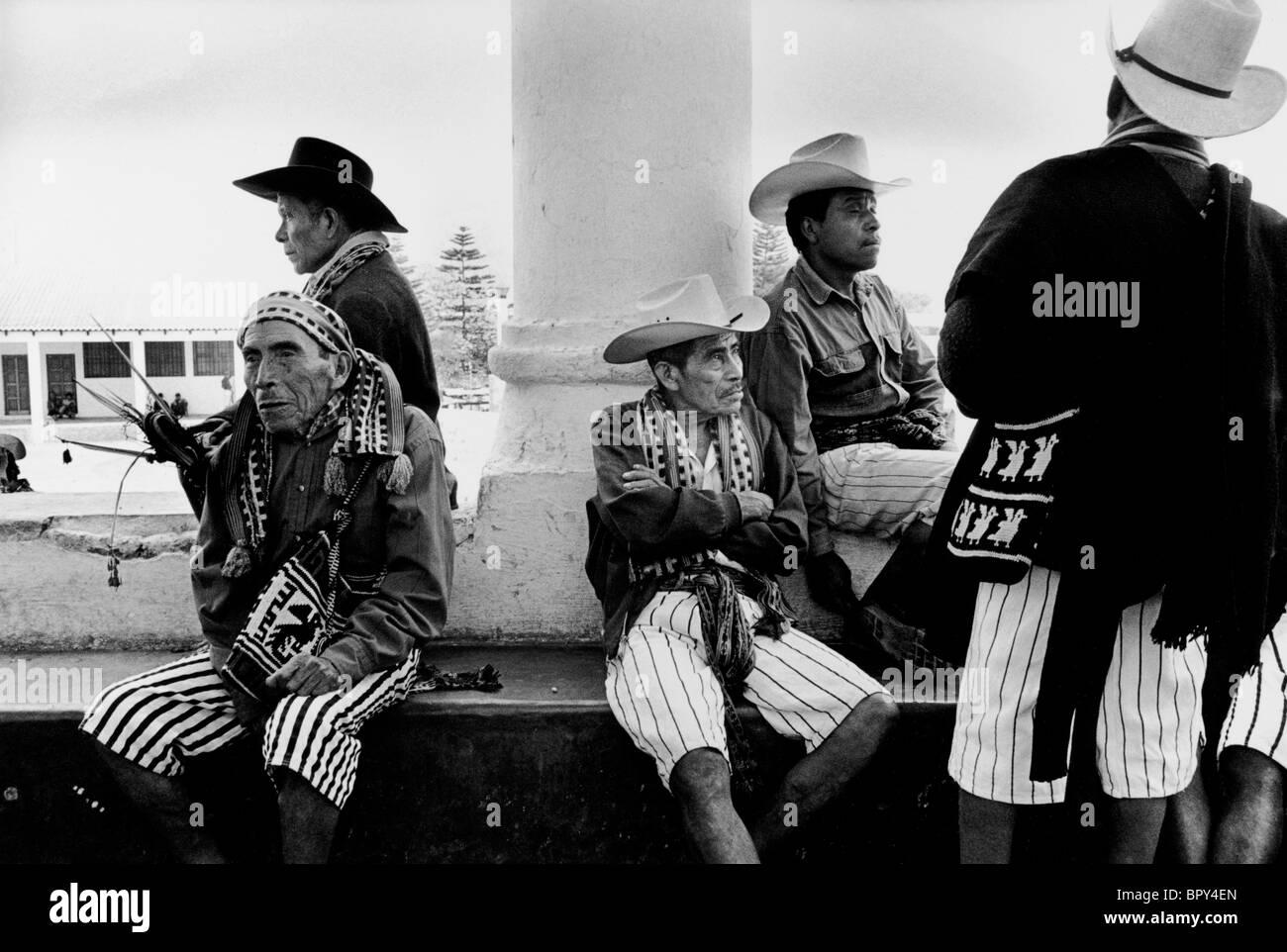 Cofradia in traditional dress gathering in Satiago Atitlan. Guatemala - Stock Image