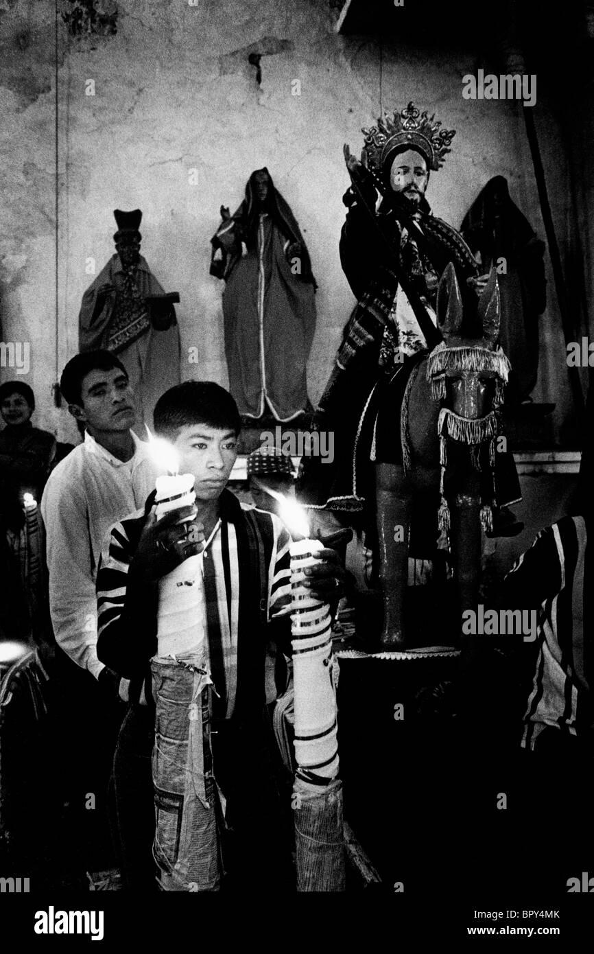 Holy Week, Santiago Atitlan. Guatemala. 1998. Inside the church awaiting the crucifiction of Christ on Good Friday. - Stock Image