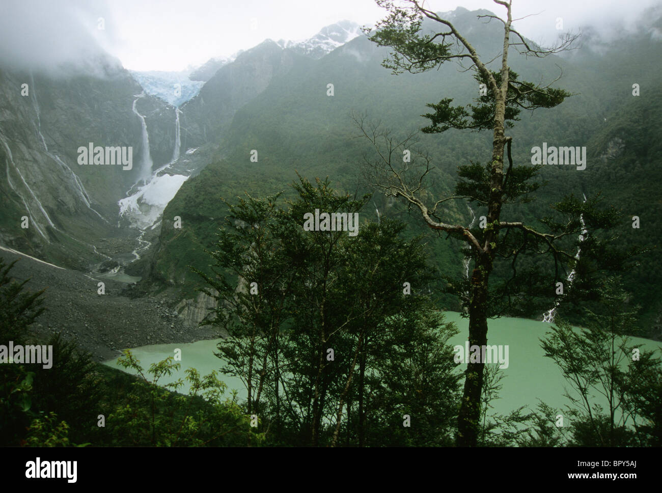 Waterfalls cascade from a hanging glacier in Queulat National Park, Southern Chile - Stock Image
