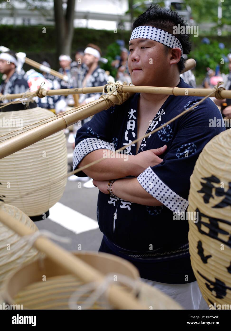 Japanese man carrying lanterns at Akita Kanto Matsuri Lantern Festival Stock Photo