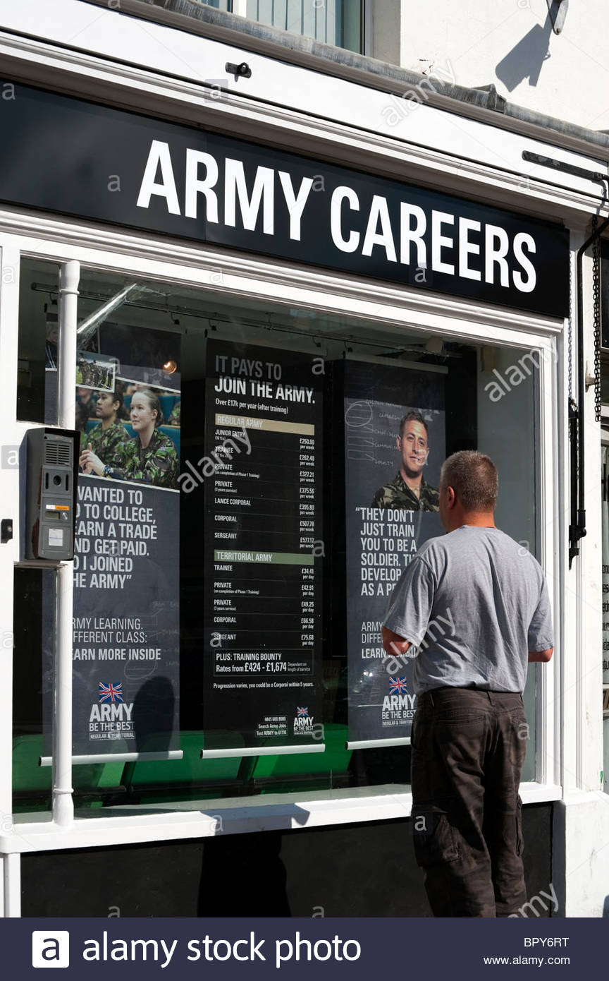 Man looking in the window of an army recruitment office in Commercial Road, Hereford, UK. Army careers office. - Stock Image