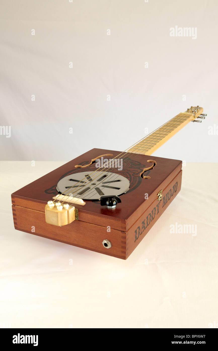 A Daddy Mojo 5 string cigar box guitar made in Canada in