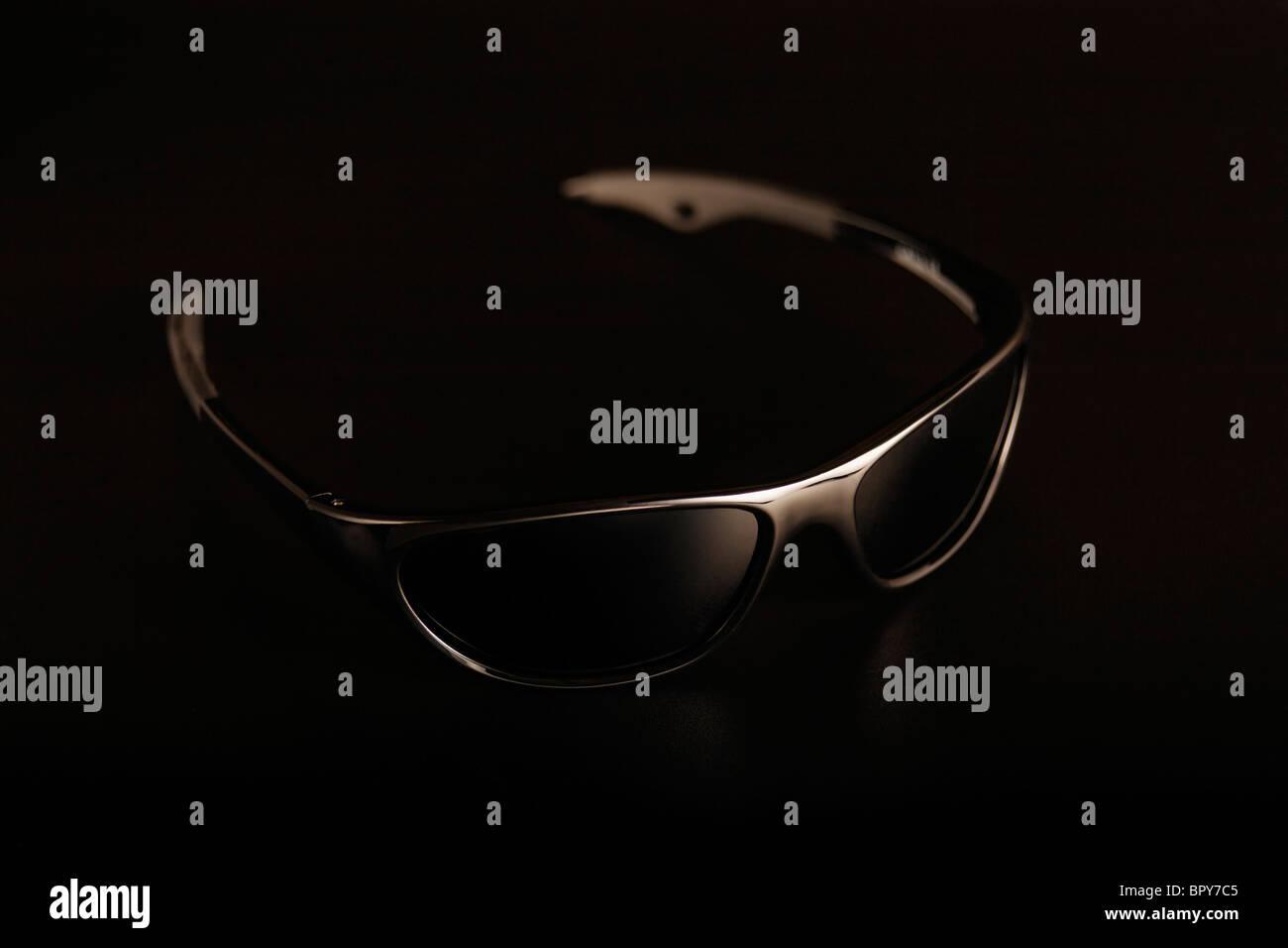 Sport sunglass on Black Background - Stock Image