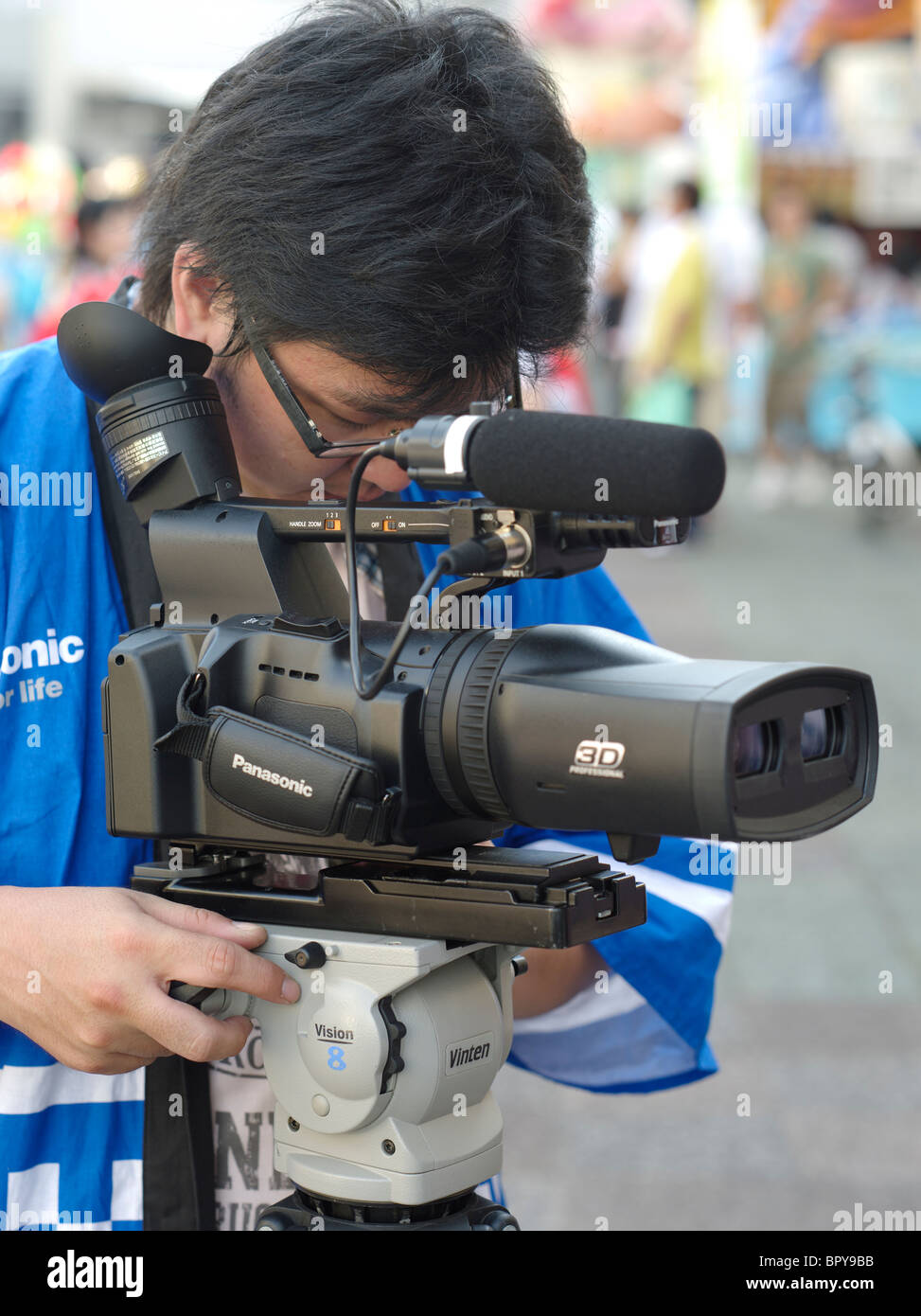 Panasonic employee recording the Nebuta Matsuri with a 3D video camera 	 Integrated Twin-lens 3D Camera Recorder - Stock Image