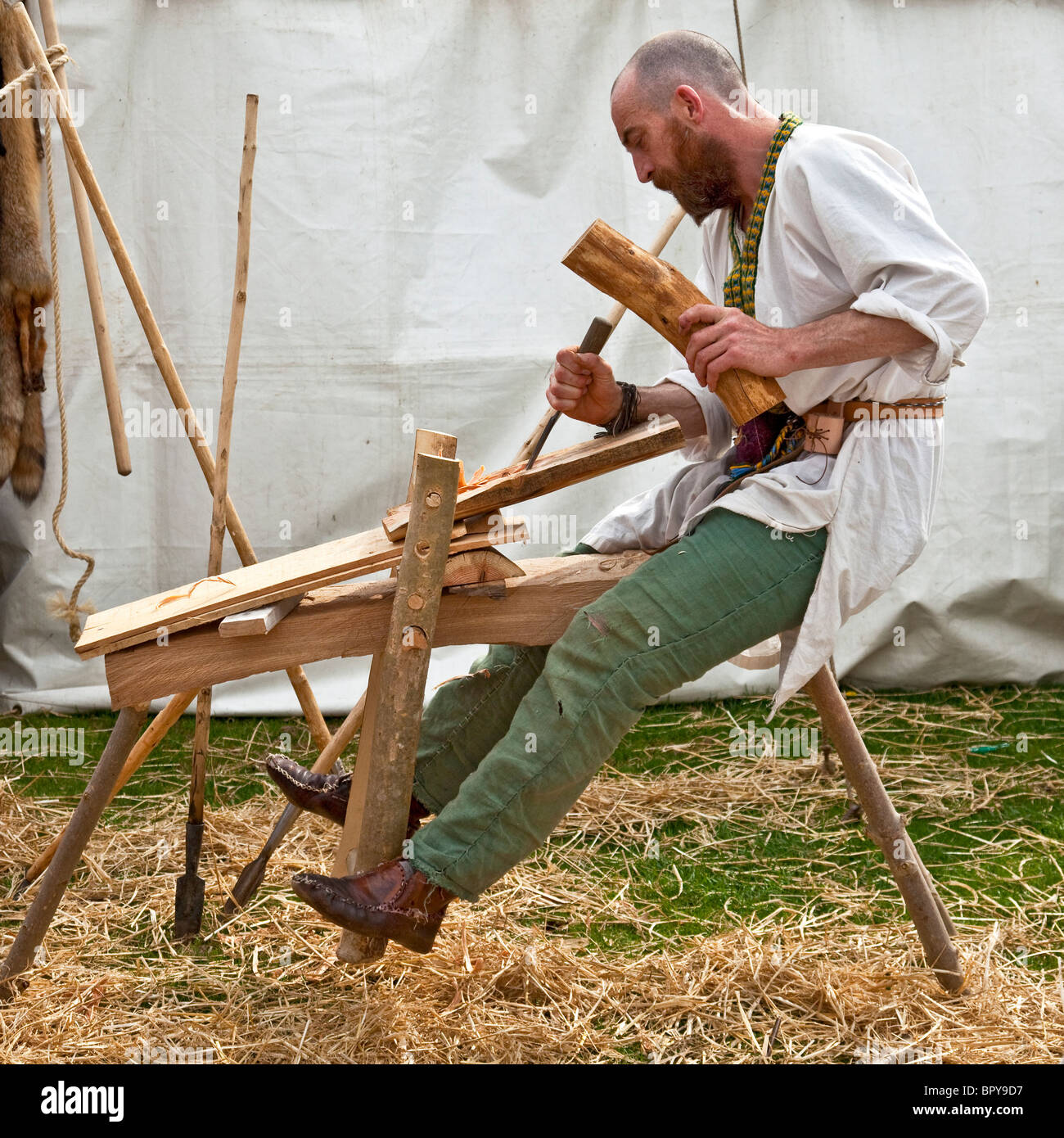 Male re-enactor demonstrating 13th century woodcarving methods at Largs Viking Festival, 2010 - Stock Image