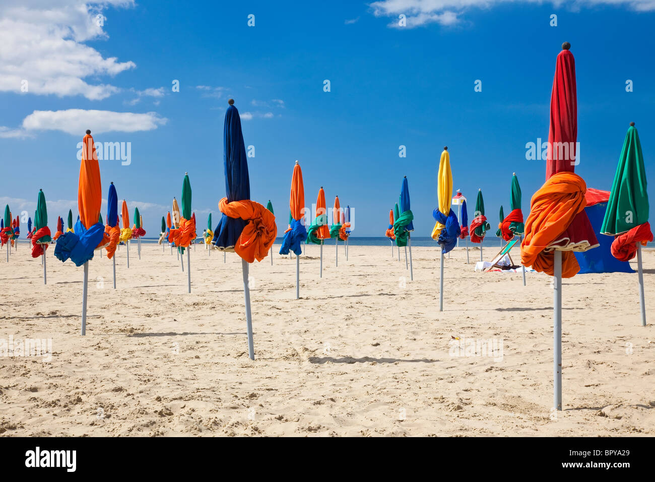 The famous colorful parasols on Deauville Beach, Normandy, Northern France, Europe - Stock Image