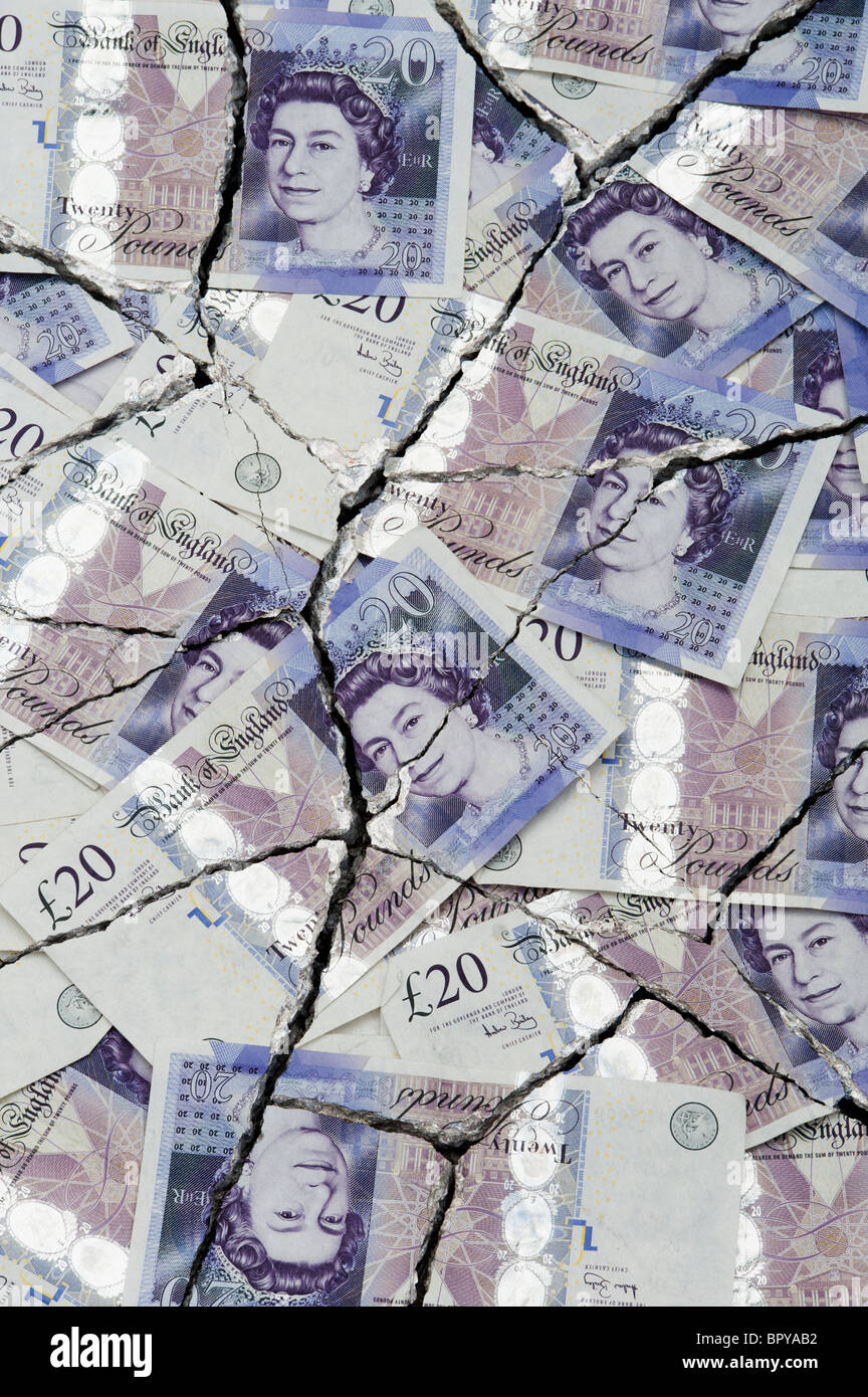 Cracked Twenty pound notes concept to represent an economic crisis - Stock Image