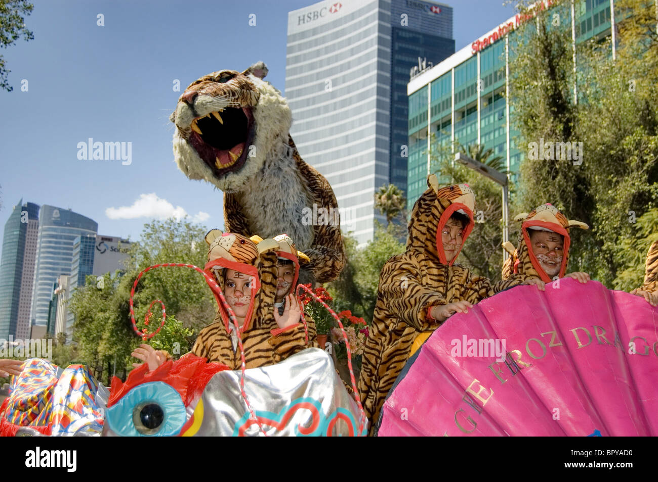 Kids with tiger costumes during a Chinese new year´s parade - Stock Image