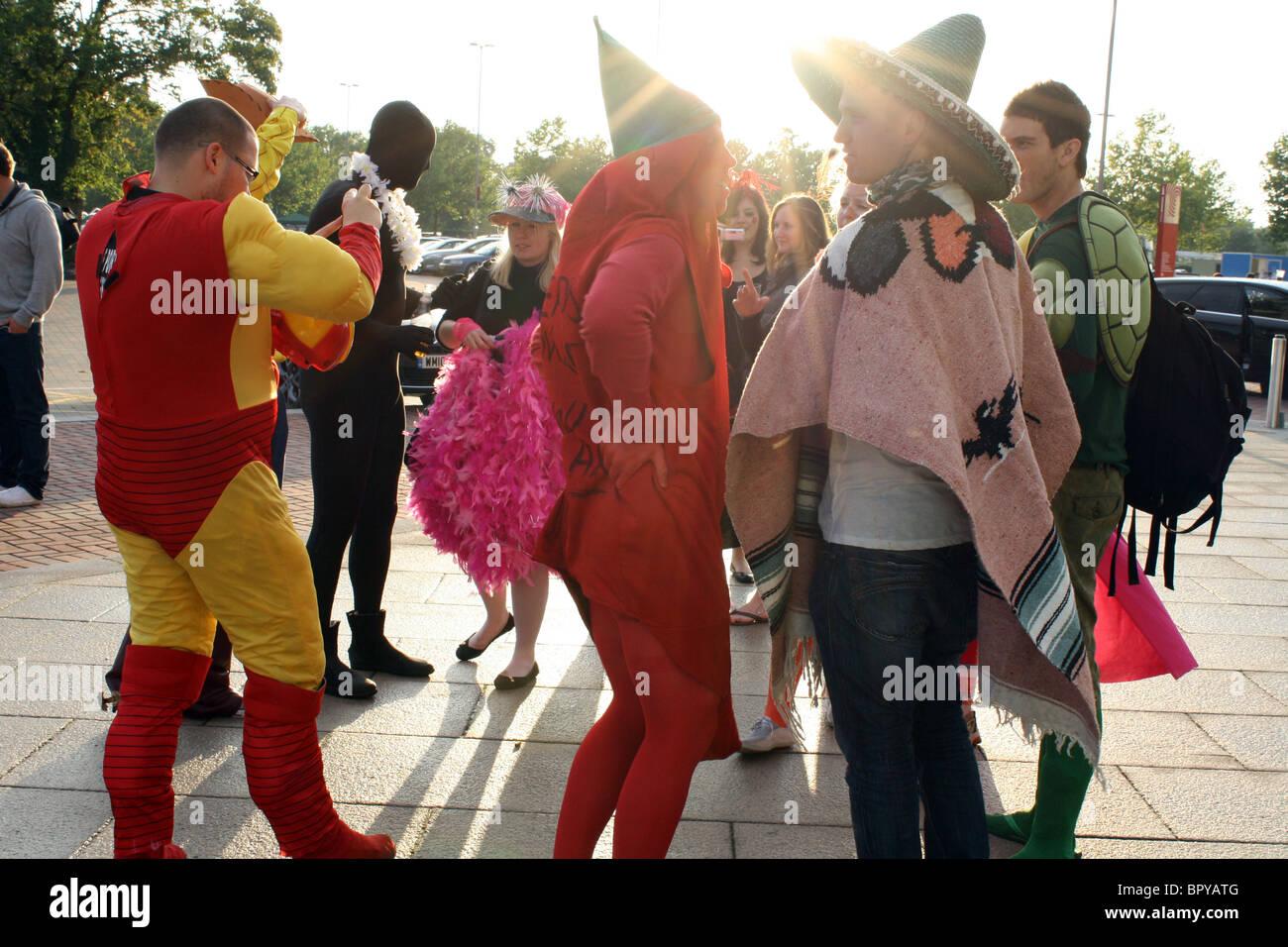 People in fancy dress outside Twickenham rugby stadium London - Stock Image