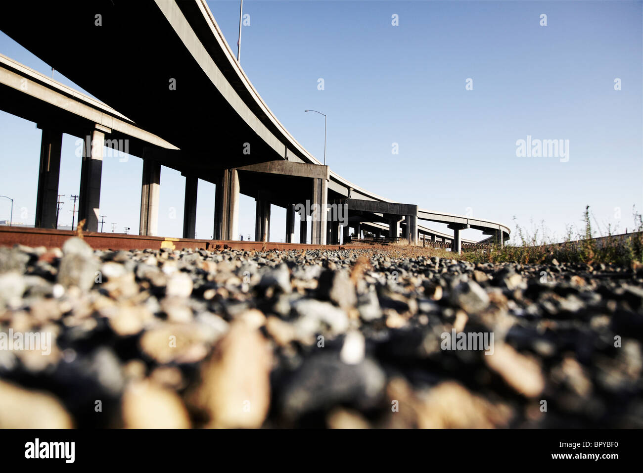 Industrial landscape with highway overpass - Stock Image