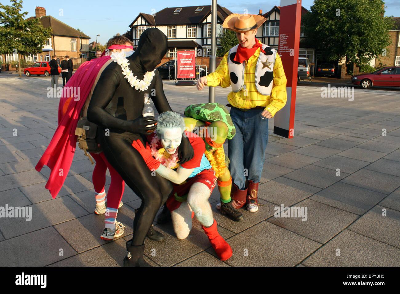 Men in fancy dress outside Twickenham rugby stadium London - Stock Image