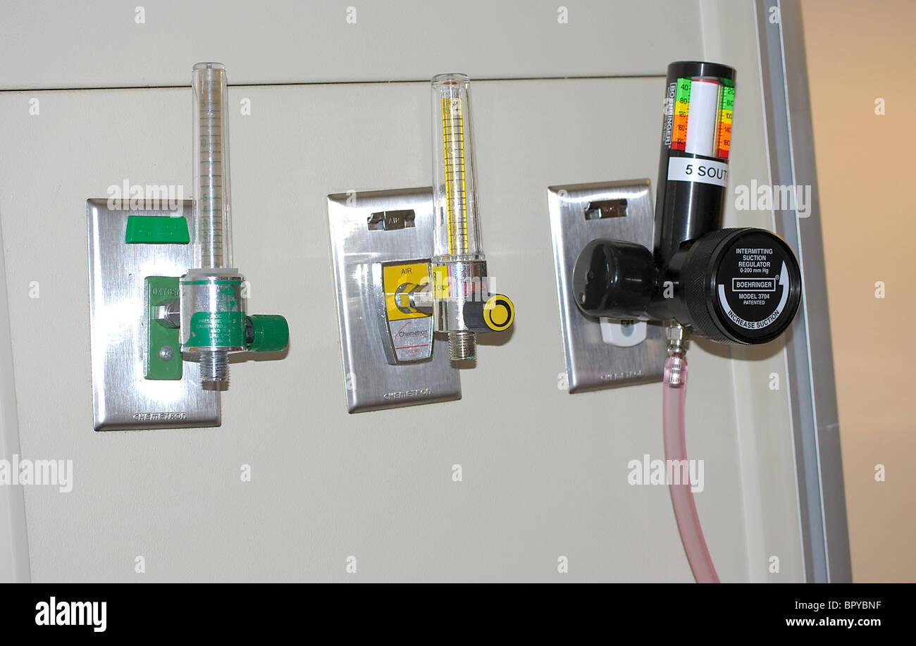 hospital medical equipment, air, oxygen, suction regulator valves. - Stock Image