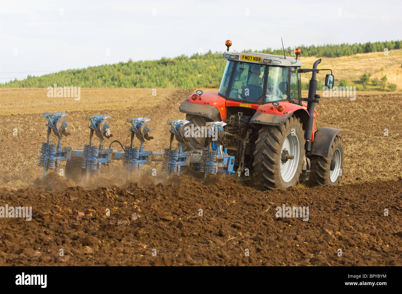 Massey Ferguson 7490 Dyna VT tractor ploughing fields with plough. - Stock Image