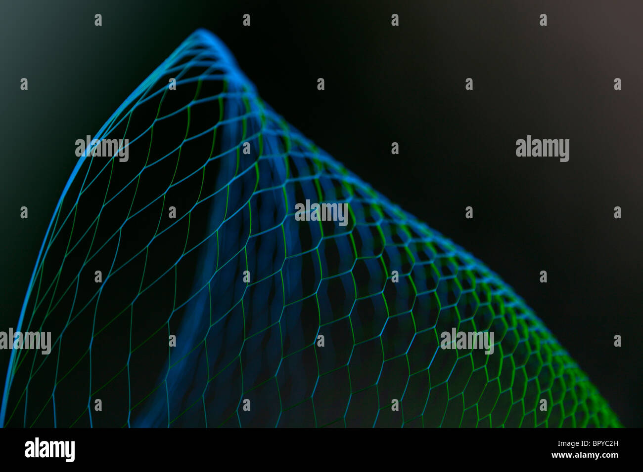 Illuminating wire frame basket with a black background - Stock Image