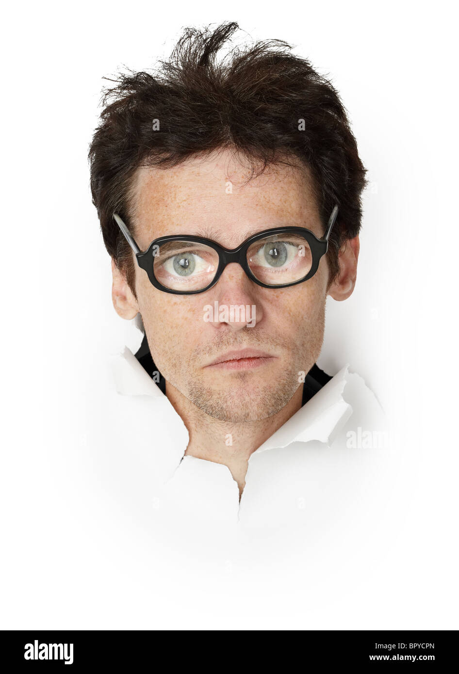 Funny man in an old-fashioned spectacles - head in the paper - Stock Image