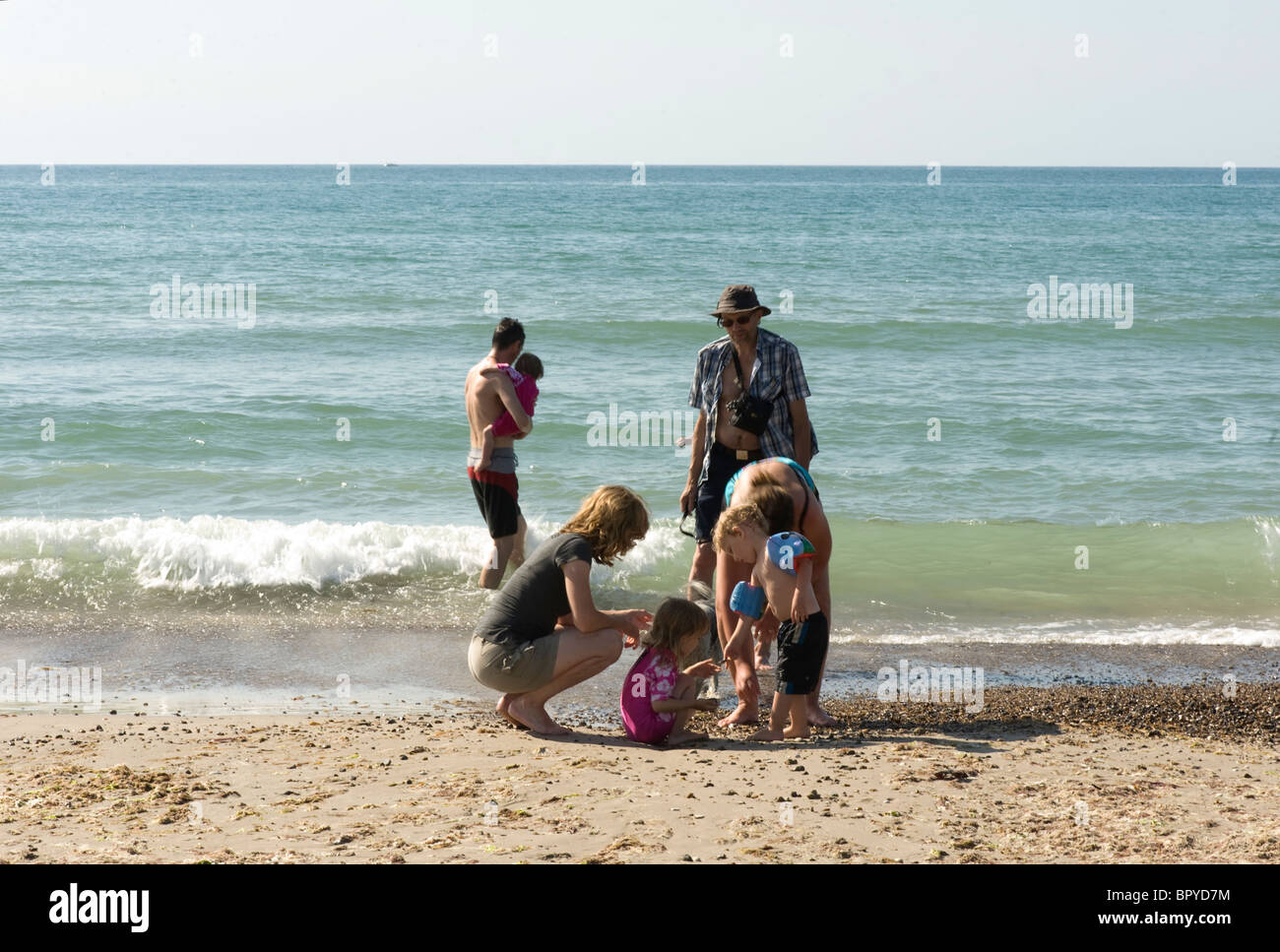 Family (3 generations) on holiday at the beach - Stock Image