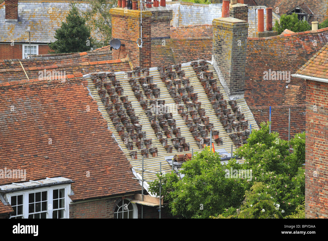 An old cottage having its roof replaced in Rye, East Sussex, England. - Stock Image