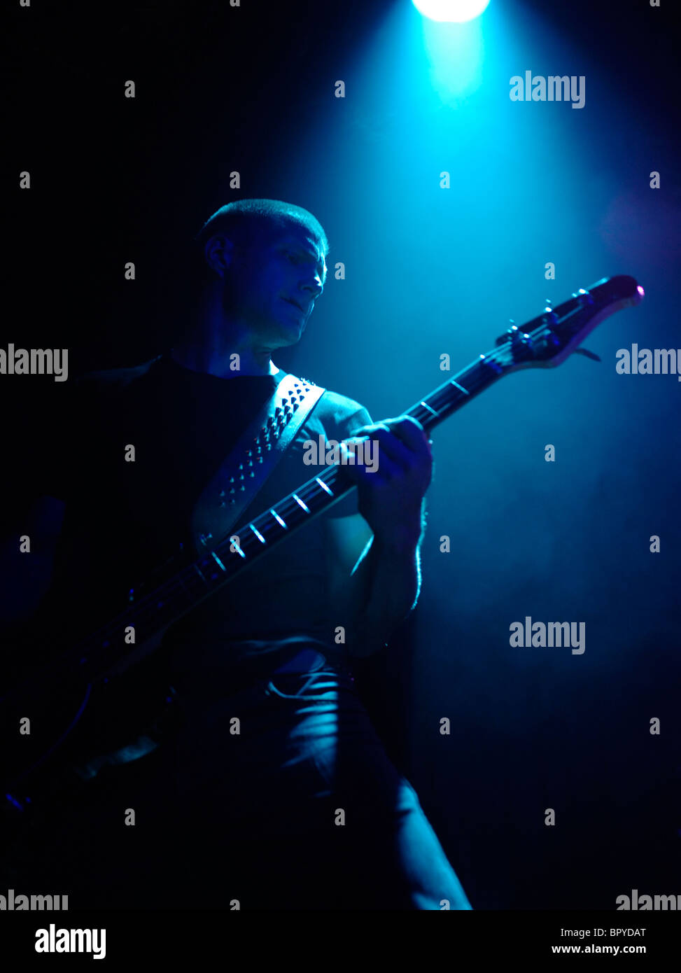 Bass guitarist in the spotlight - Stock Image