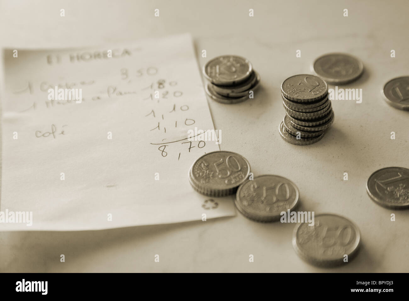 french coins paying a restaurant bill - Stock Image