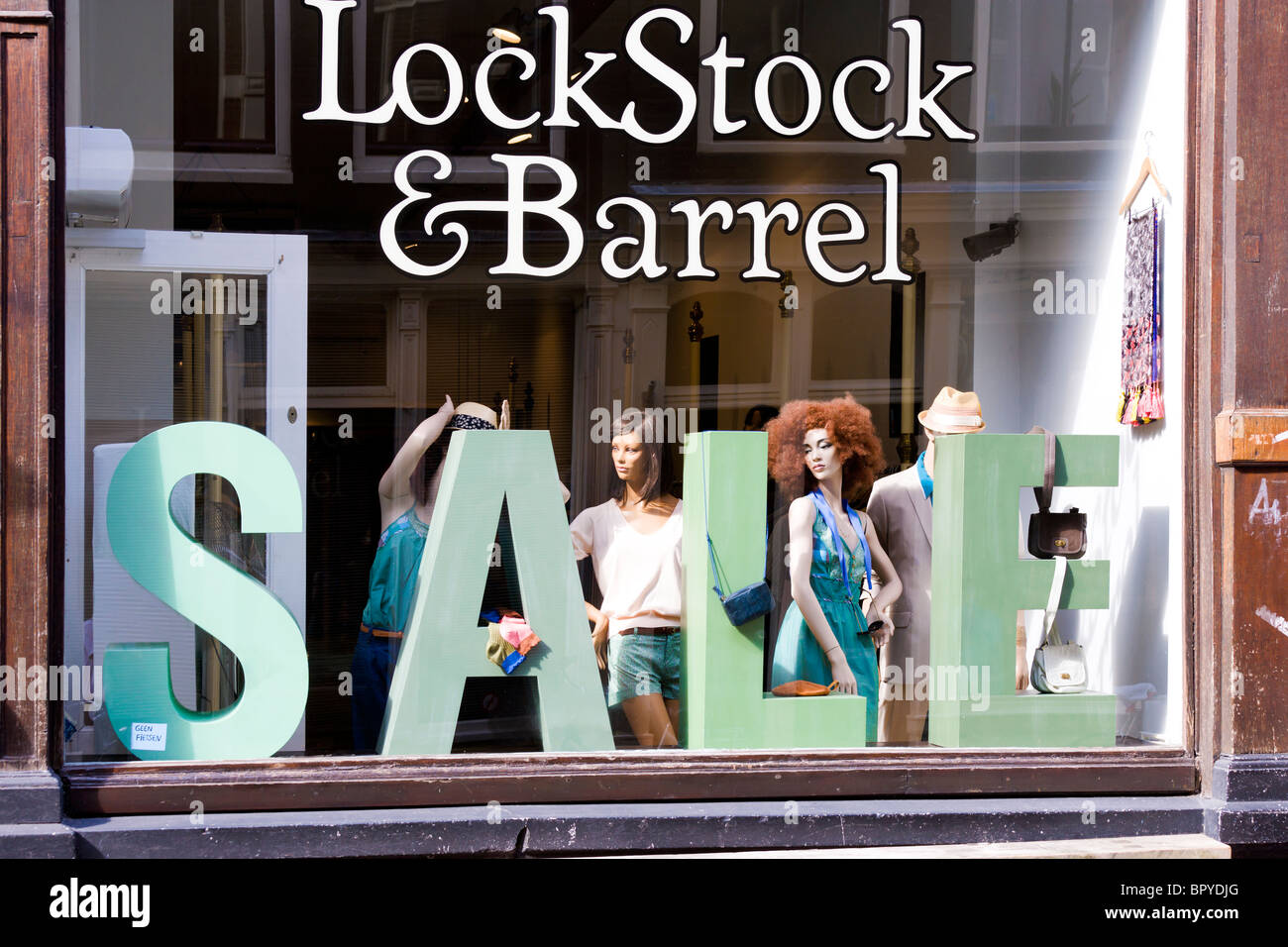 Amsterdam. Sale at Lock, Stock and Barrel designer fashions shop for men and women in the Nine Little Streets shopping - Stock Image