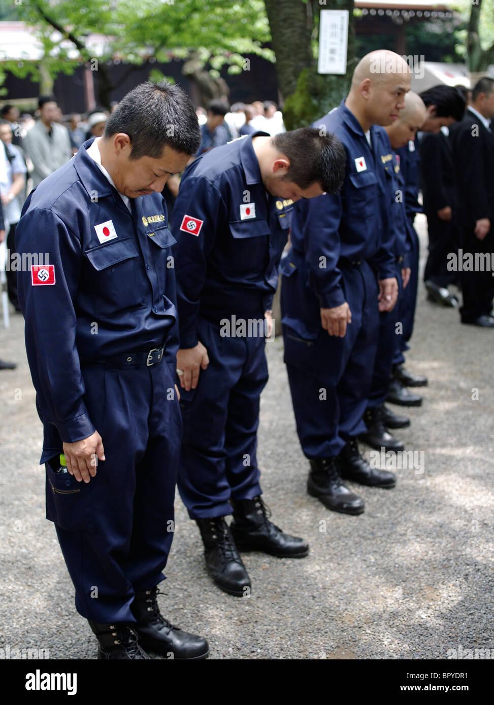Extreme Far right nationalists at Yasukuni Shrine on August 15 anniversary. Japanese flag and Nazi Swastika on uniform. - Stock Image