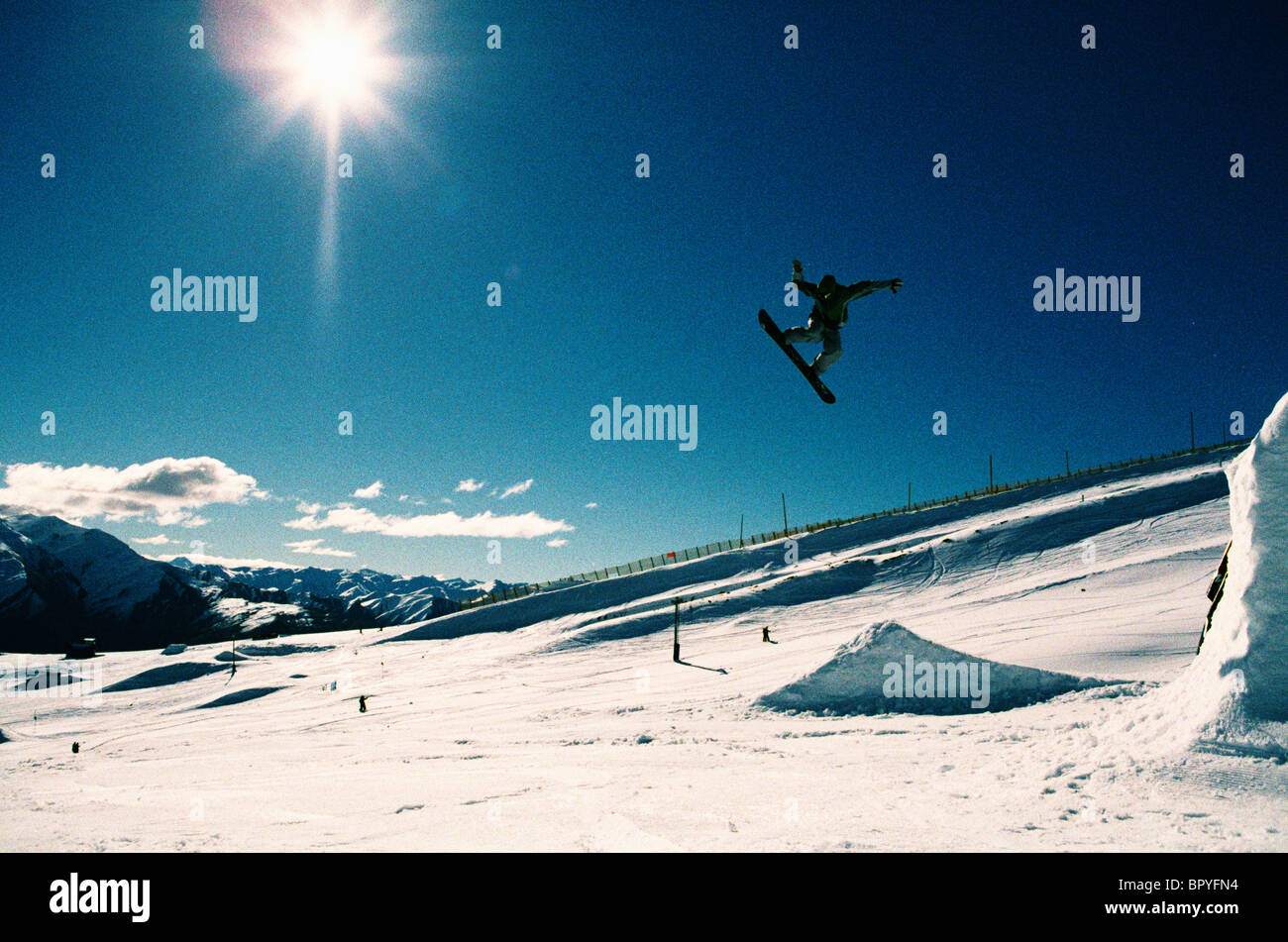 Big air in the snowboard park, out of control. - Stock Image