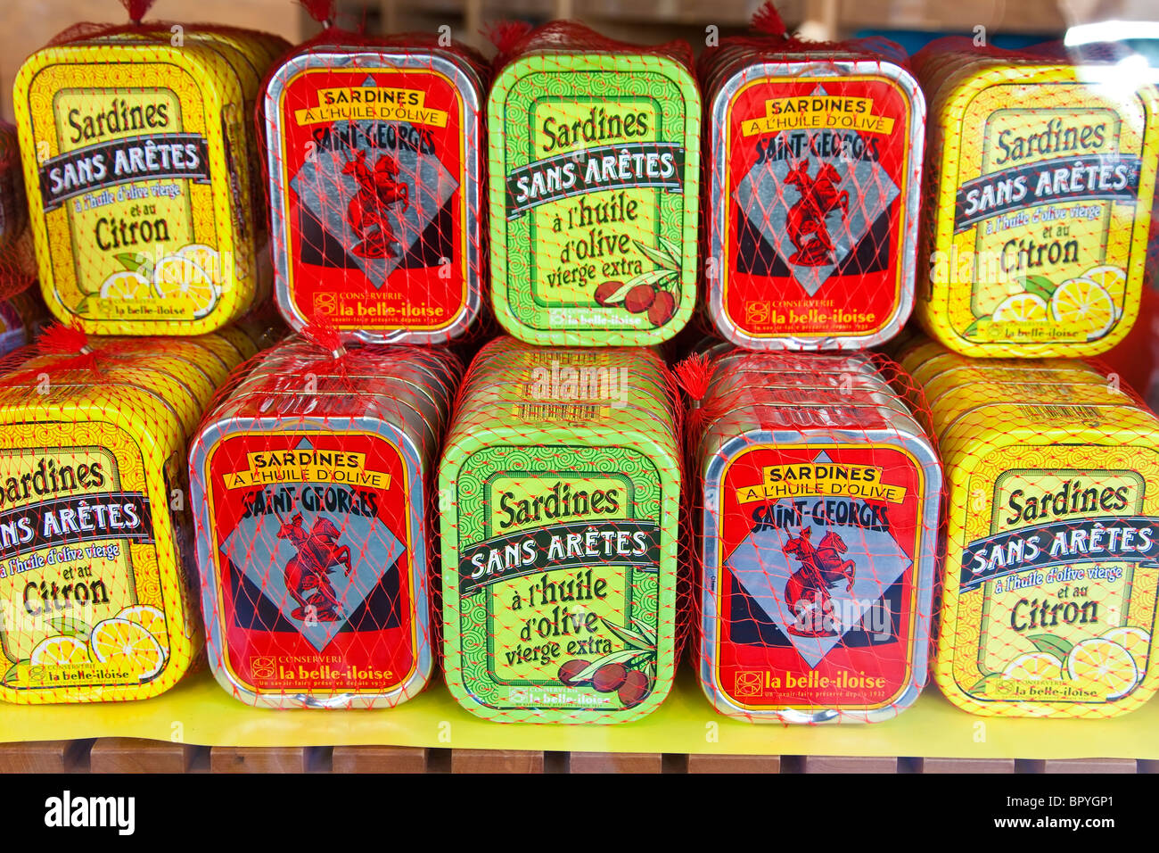 Tins of fish, tuna, sardines & mackerel, for sale in a French food shop, Deauville, Normandy - Stock Image