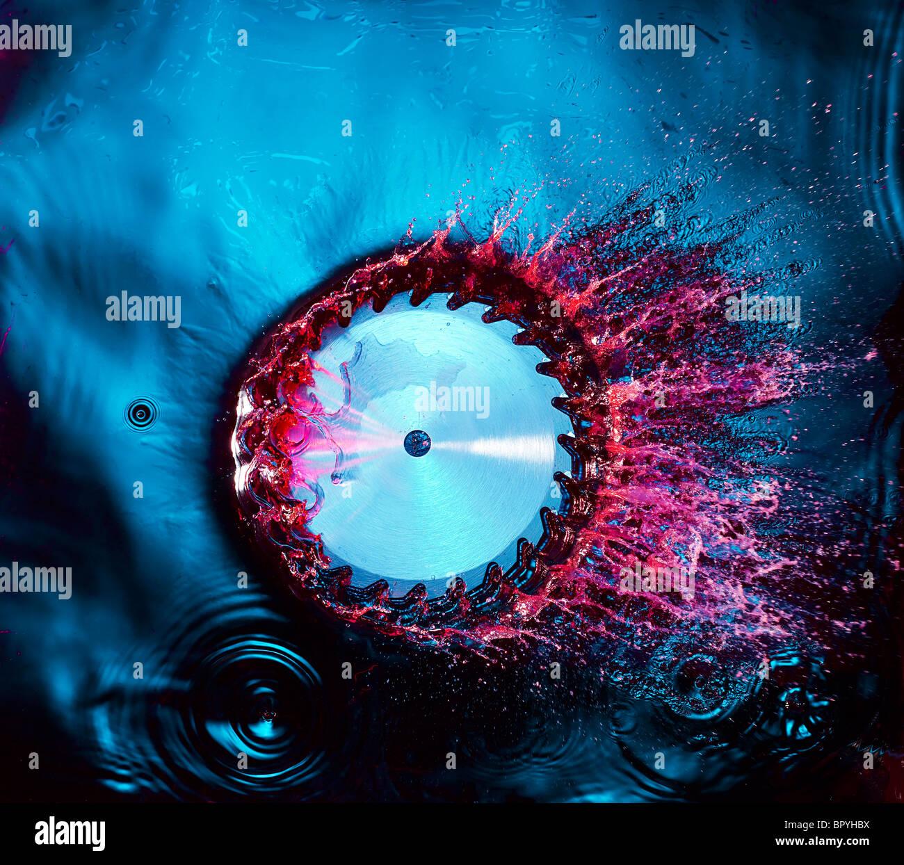 saw splashing in blue water Stock Photo